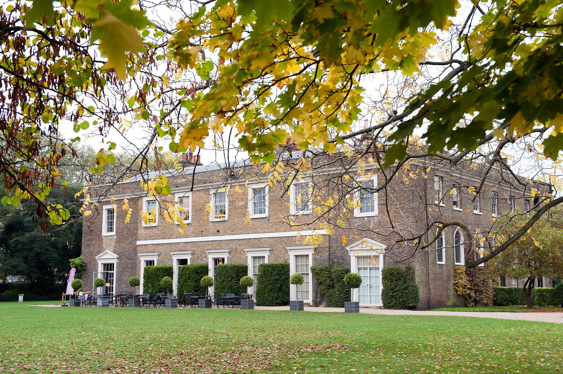 Fulham Palace view from the south lawn through the Autumn trees