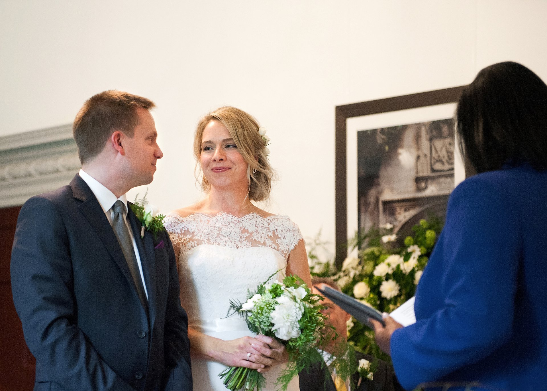 The bride and groom smile at each other at the start of their Fulham Palace wedding