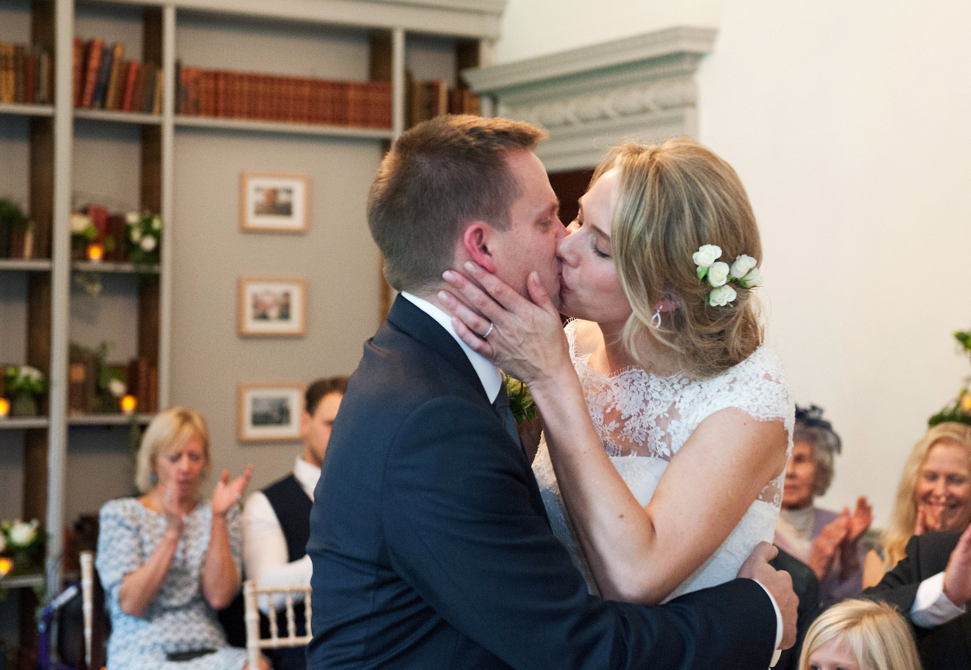 Bride & groom kiss to celebrate their Fulham Palace wedding