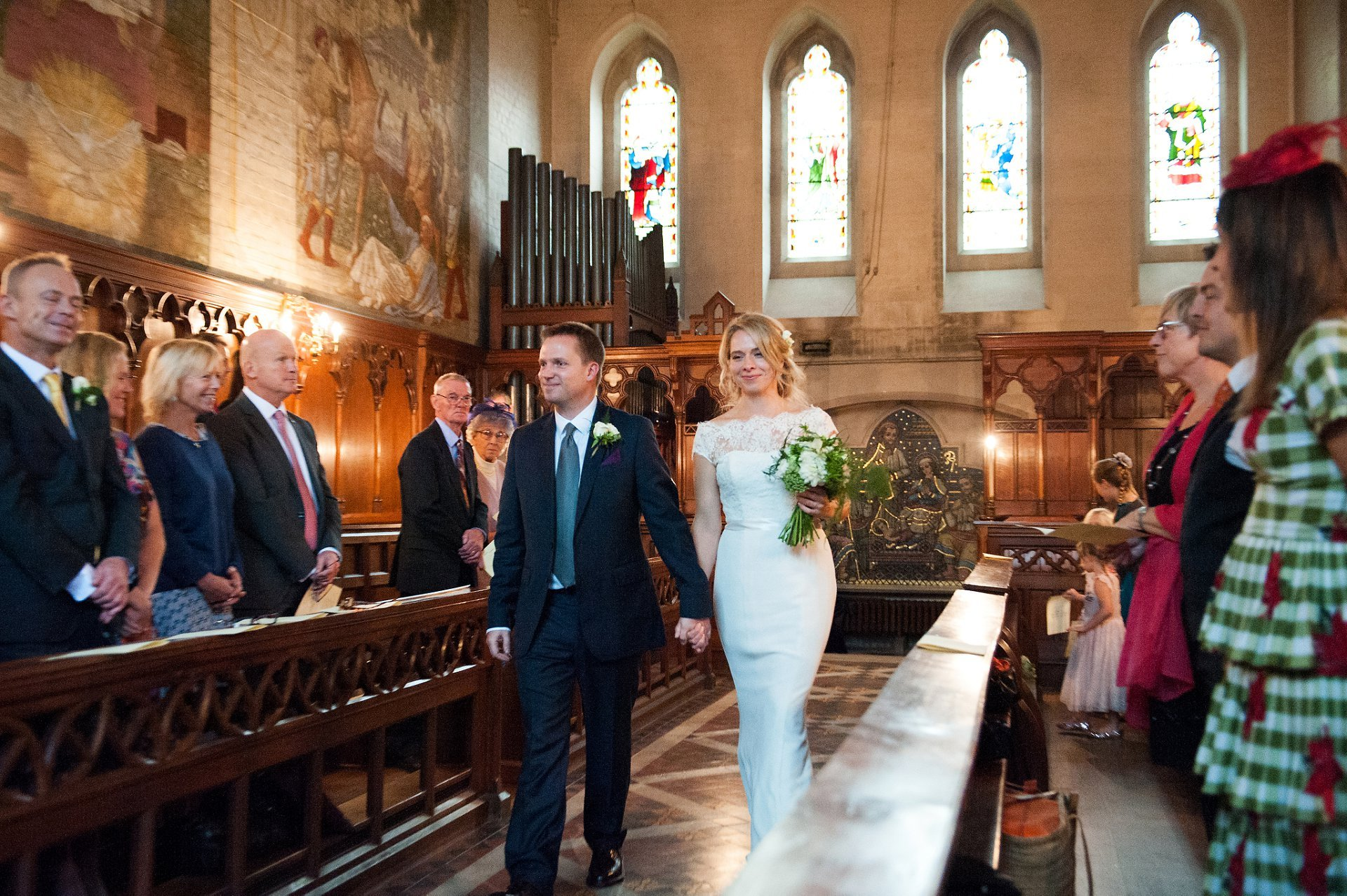 Fulham Palace Wedding Photography -bride and groom enter the tait chapel at fulham palace to have their civil marriage blessed by the vicar from local church All Saint's Putney