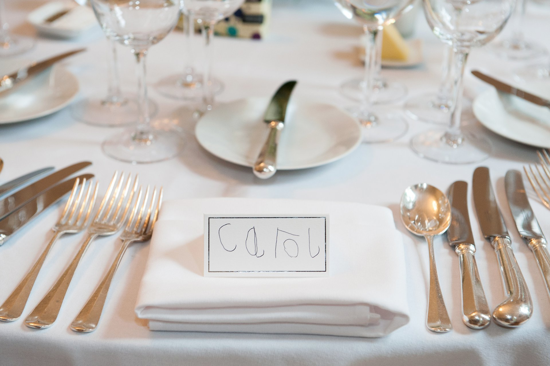 Table names by the bride and groom's daughter - thoroughly original and charming!