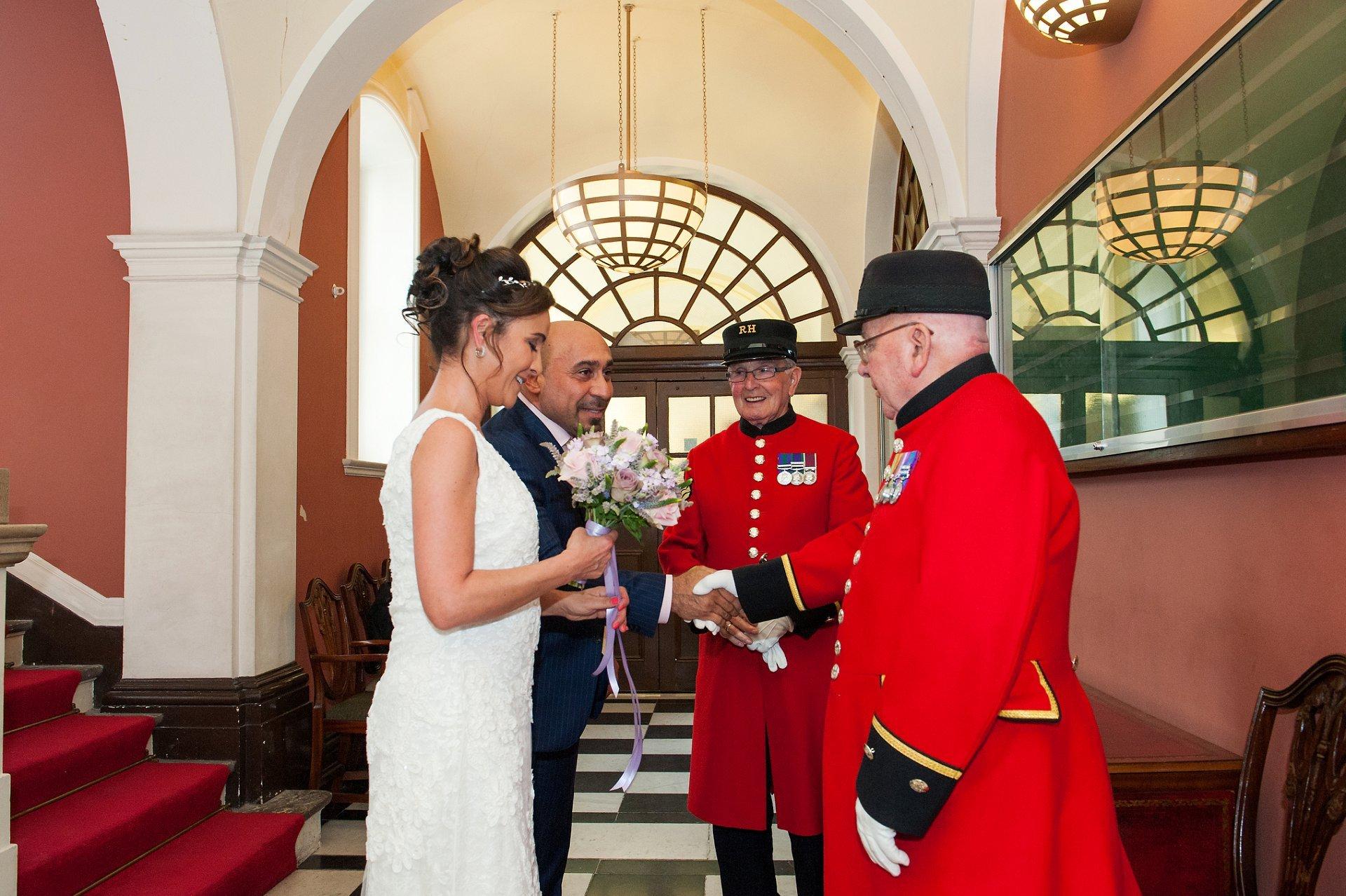 Bride & groom meet Chelsea Pensioners at Kensington & Chelsea Register Office in Chelsea Old Town Hall