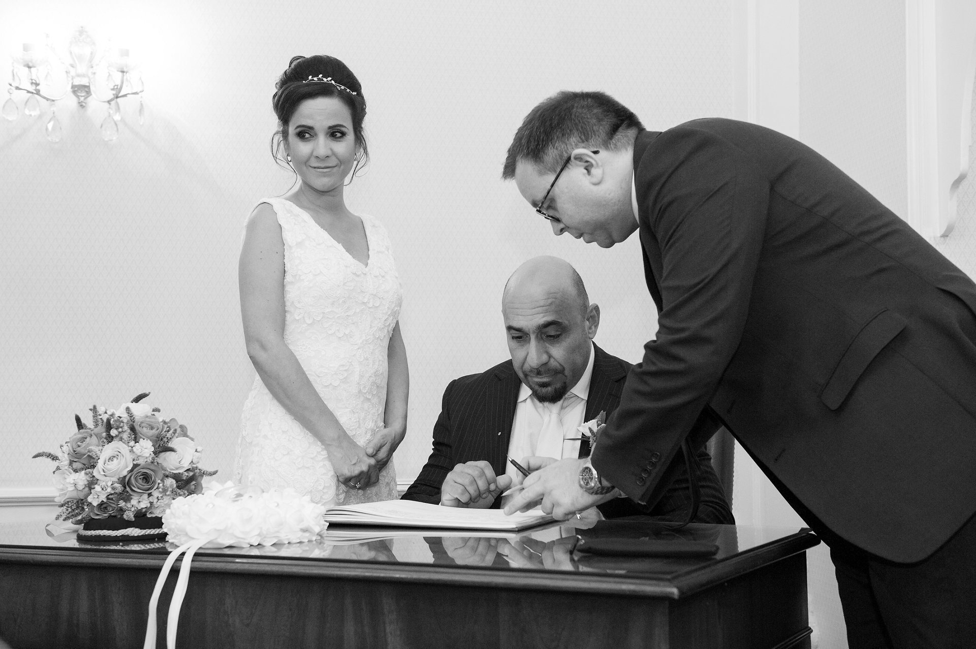 Bride & groom signing the Register at Chelsea Registry Office