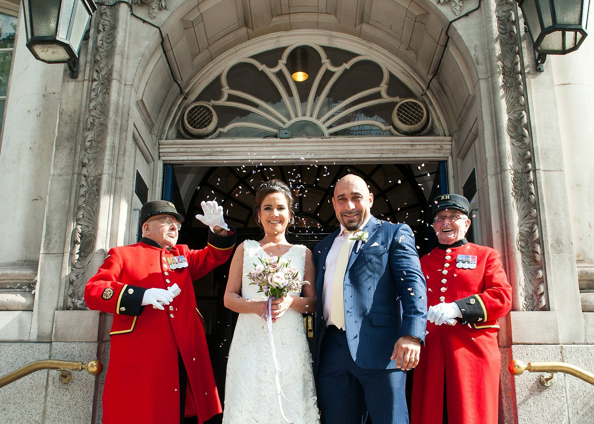Chelsea Register Office Wedding Photography - the famous steps outside Chelsea Registry Office (Chelsea Old Town Hall) - perfect for confetti... even more perfect with Chelsea Pensioners!