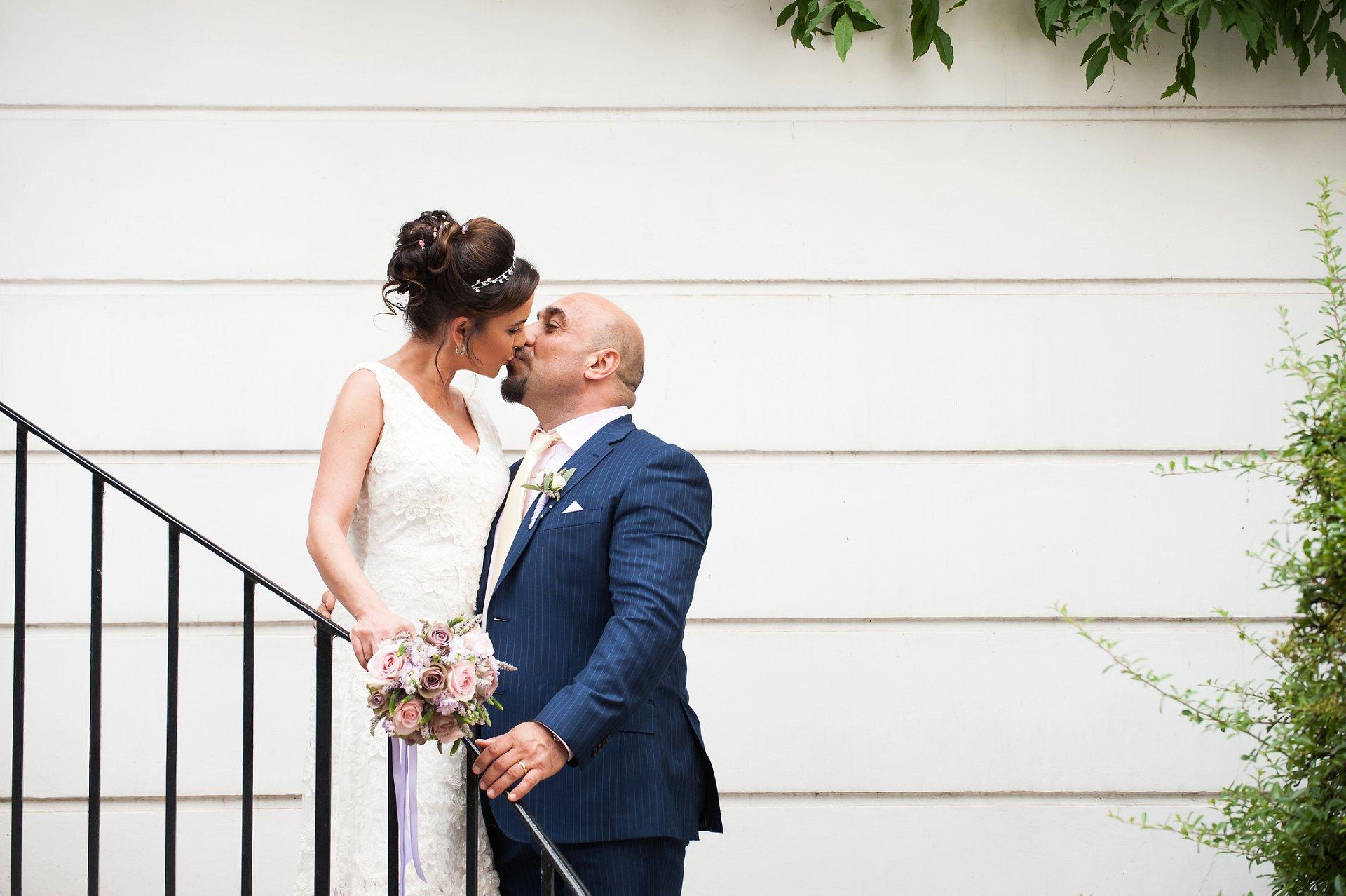 Bride & groom kiss in Chelsea
