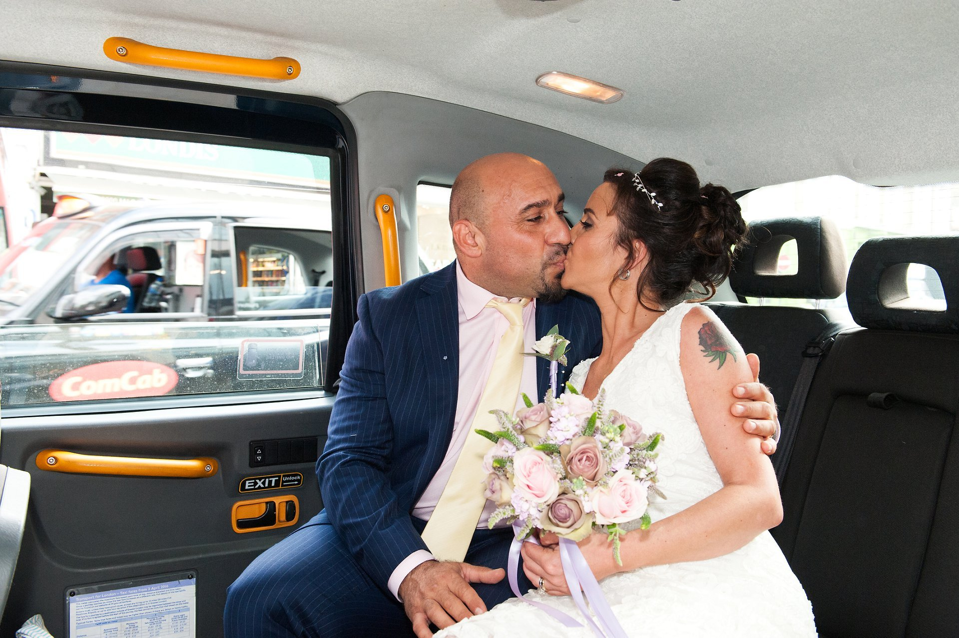 Bride & groom inside a London taxi on the King's Road