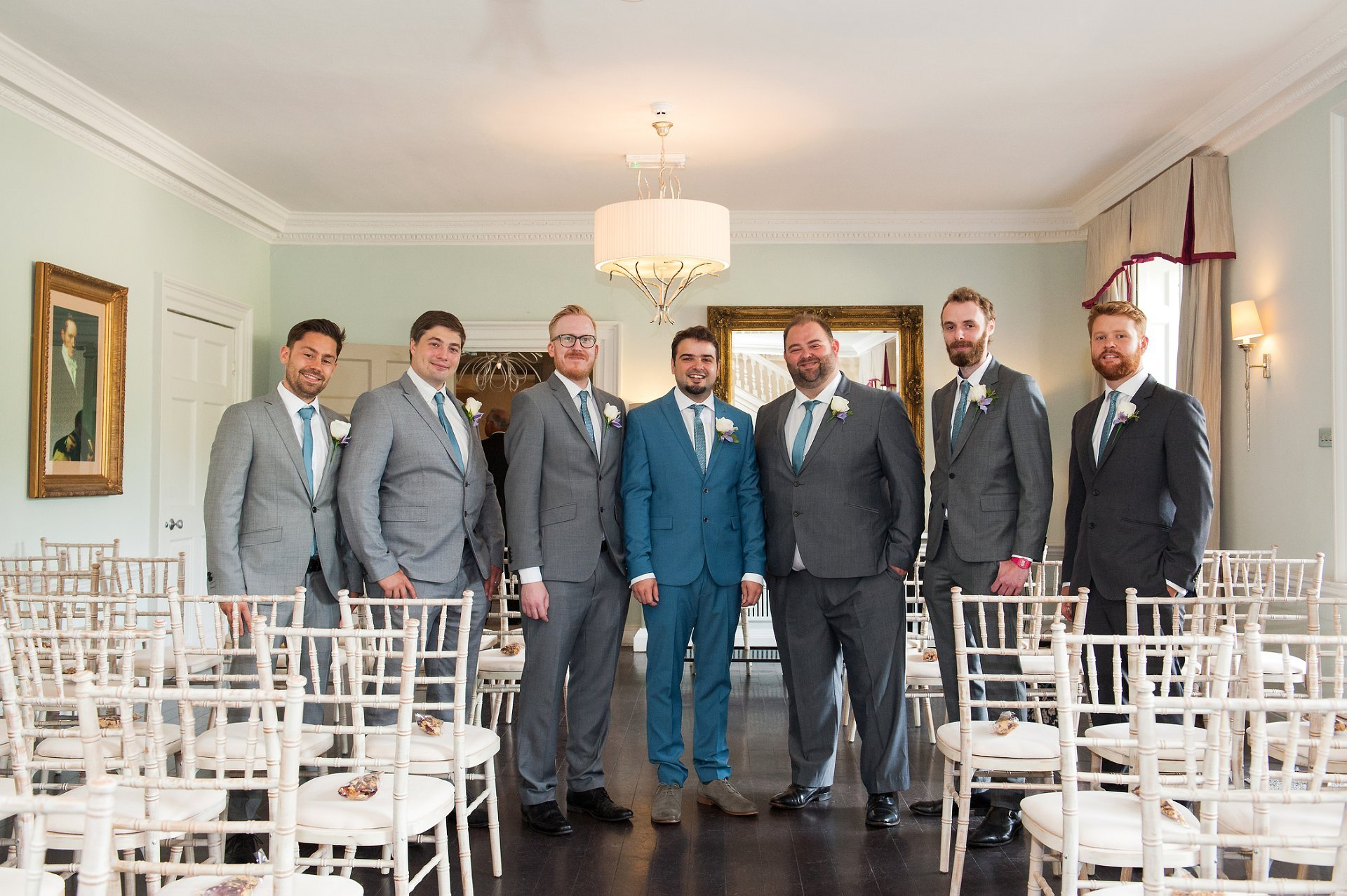 Groom, best man and ushers in the Willow Room at Morden Hall
