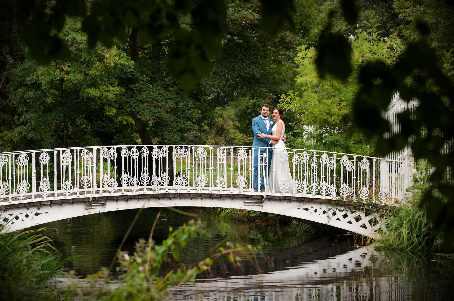 Morden Hall Wedding Photographer on the stunning white bridge which makes a wonderful backdrop for photographs