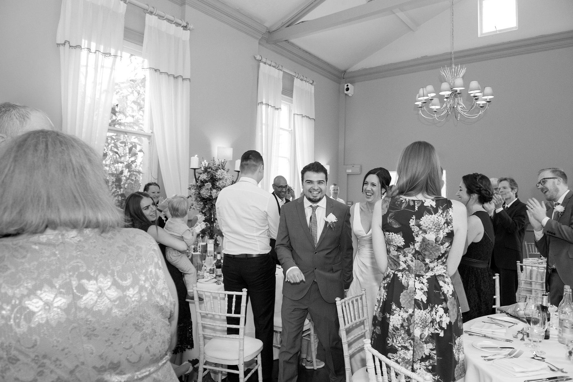 Bride & Groom enter teh Mulberry Room in Morden Hall for their wedding breakfast