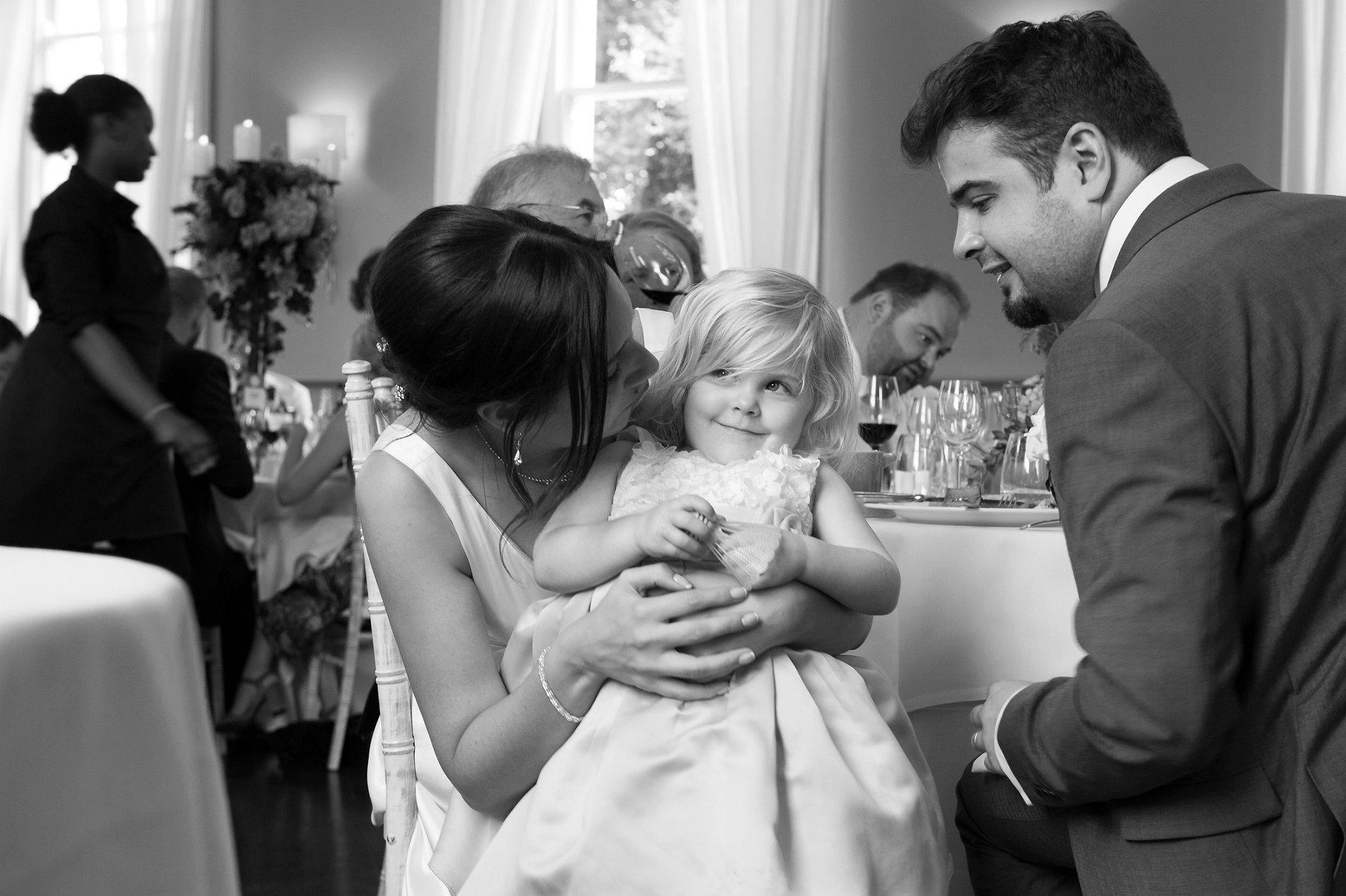Flower girl eyes up the wedding cake