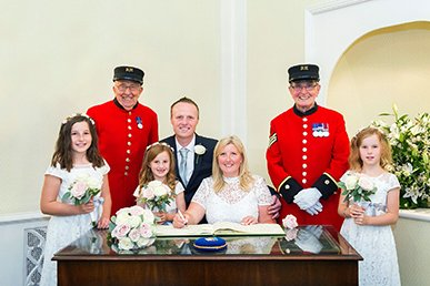 Chelsea Register Office wedding photographer Emma Duggan is a London register office and Chelsea Old Town Hall specialist offering coverage from one hour upwards for small weddings in London and the South East, providing natural and relaxed photography by a professional with over ten years experience. Here a couple, their three daugheters and two Chelsea Pensioners from the Royal Hospital pose for a photo in Chelsea Registry Office's Rossetti Room