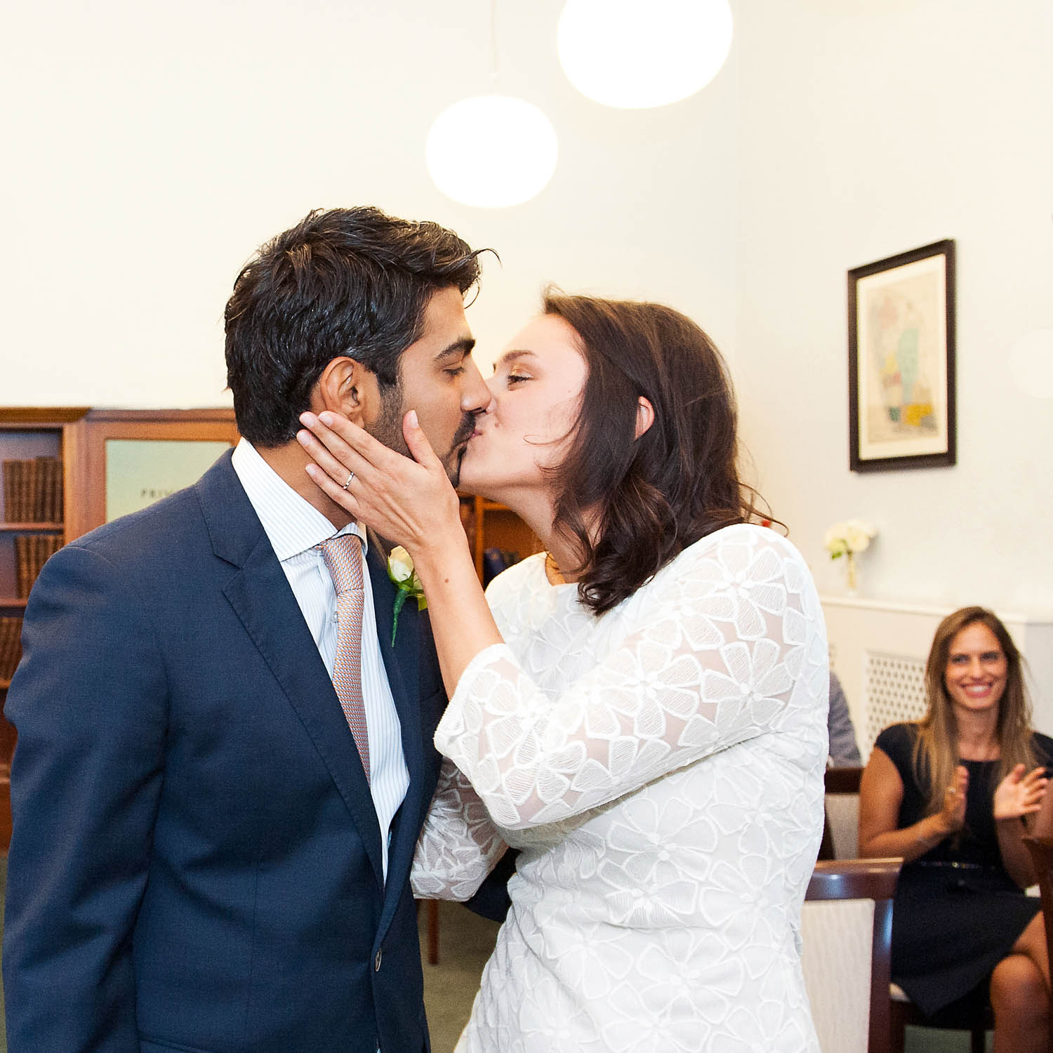 A bride and groom kiss during their civil marriage ceremony. Photo: Mayfair Library wedding photographer Emma Duggan