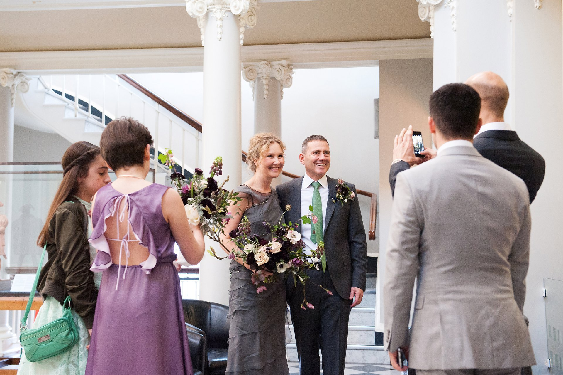 Guests take photos of the bride and groom at Greenwich Register Office, Woolwich Town Hall