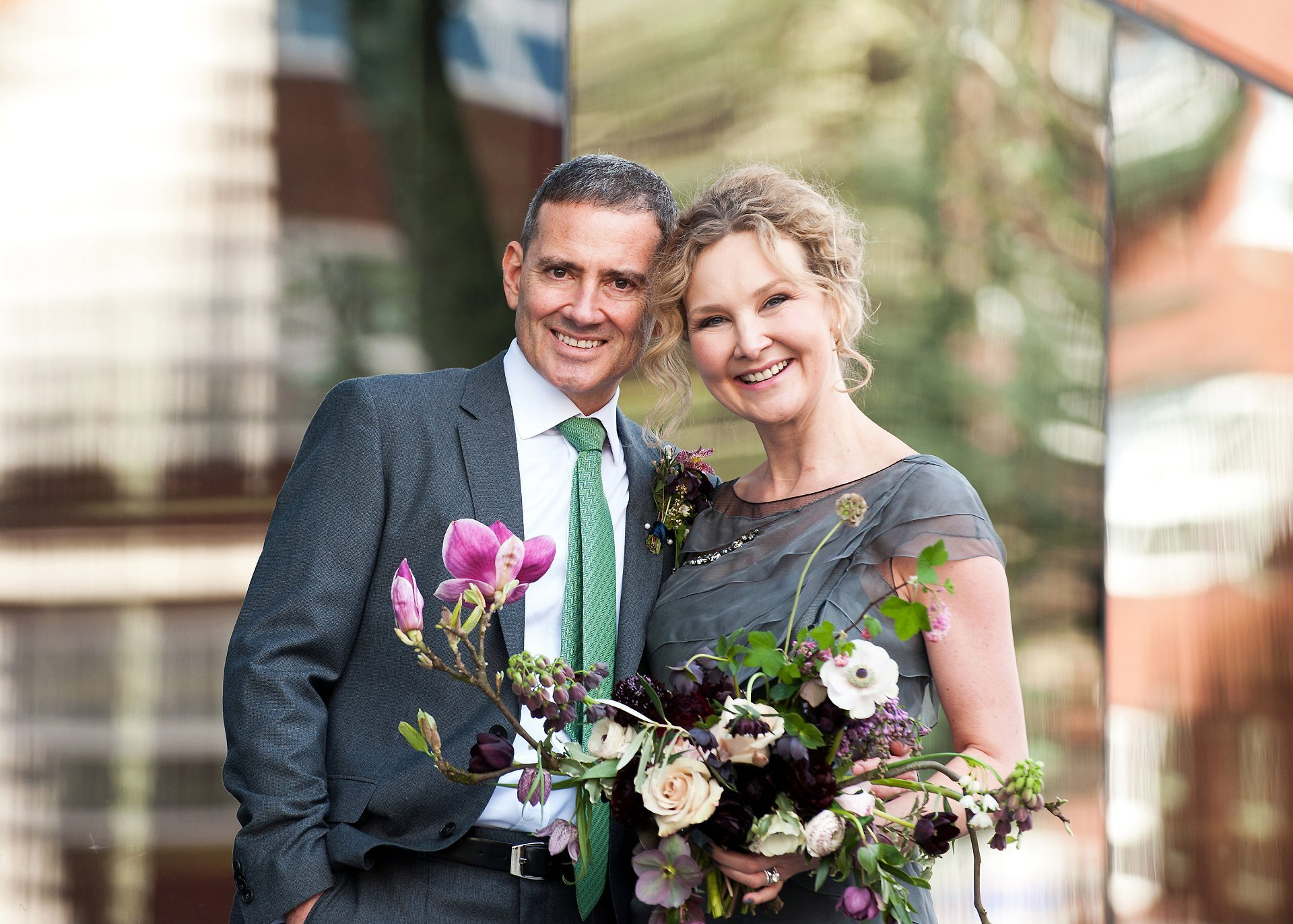 A new husband and wife stand outside Greenwich Register Office after their civil wedding ceremony at Woolwich Town Hall. Photo: Greenwich Register Office wedding photographer Emma Duggan