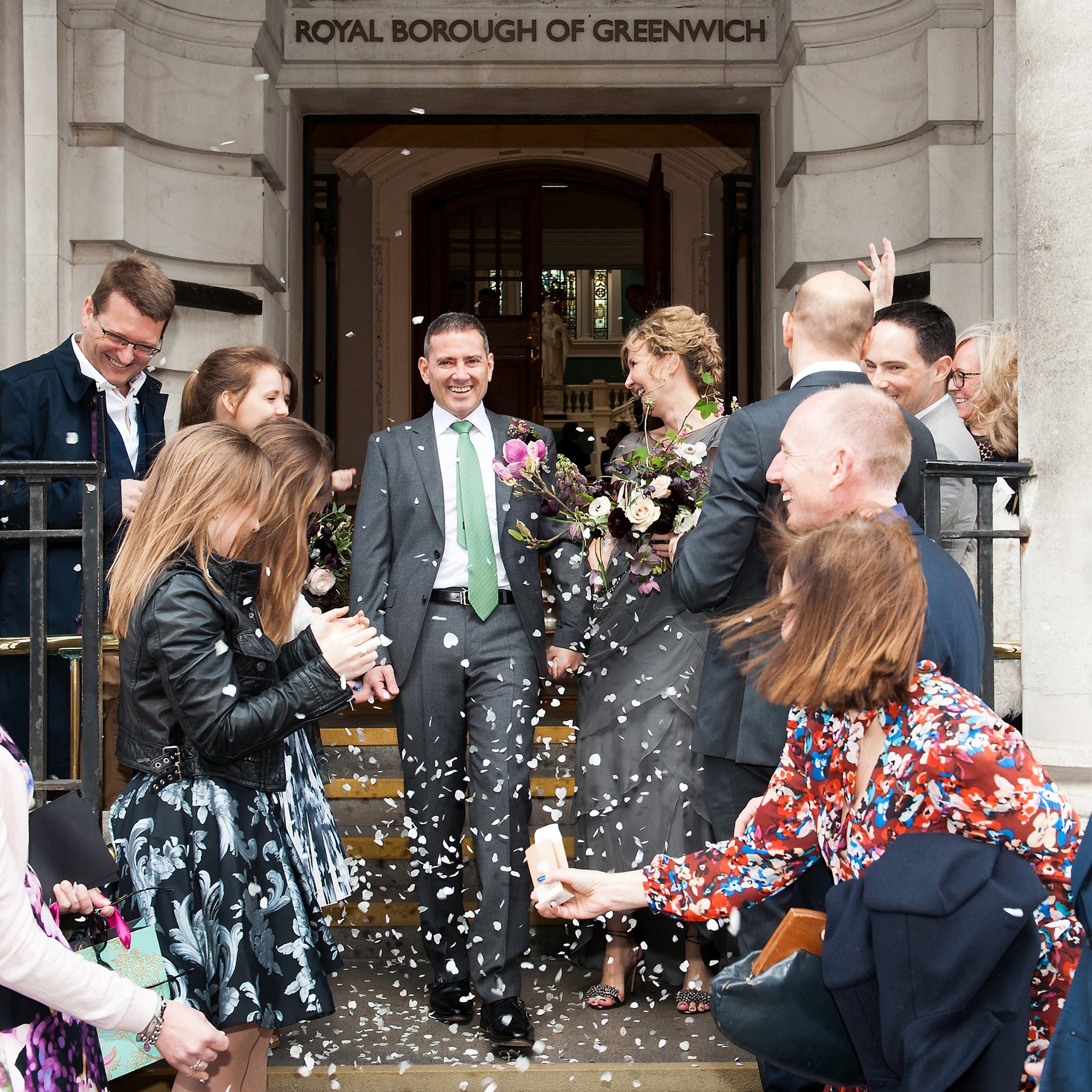Greenwich Register Office wedding photographer Emma Duggan offers photography like this bride and groom leaving Woolwich Town Hall in a whirl of confetti.
