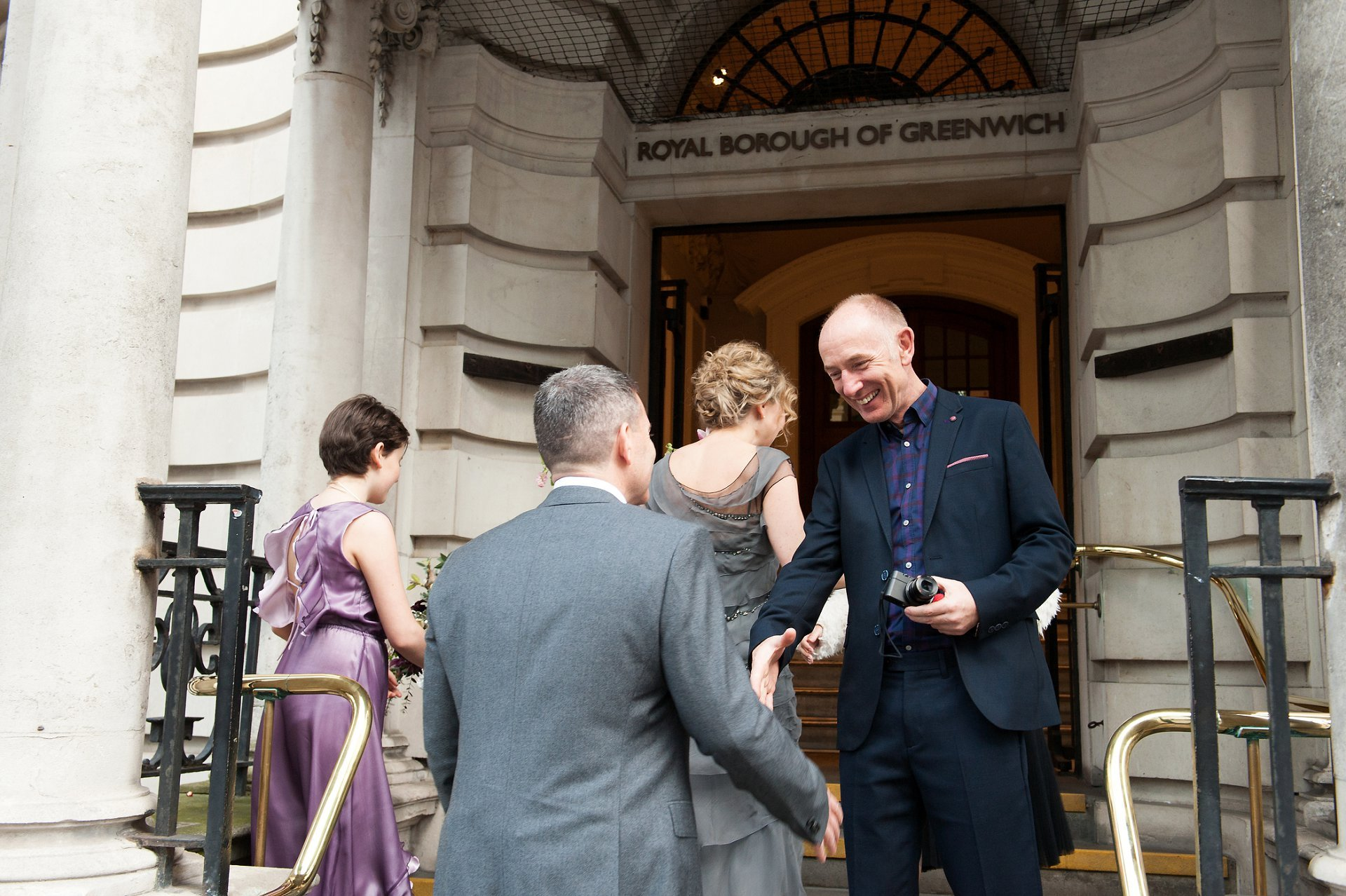 Bride & Groom greeted by guests outside Woolwich Town Hall