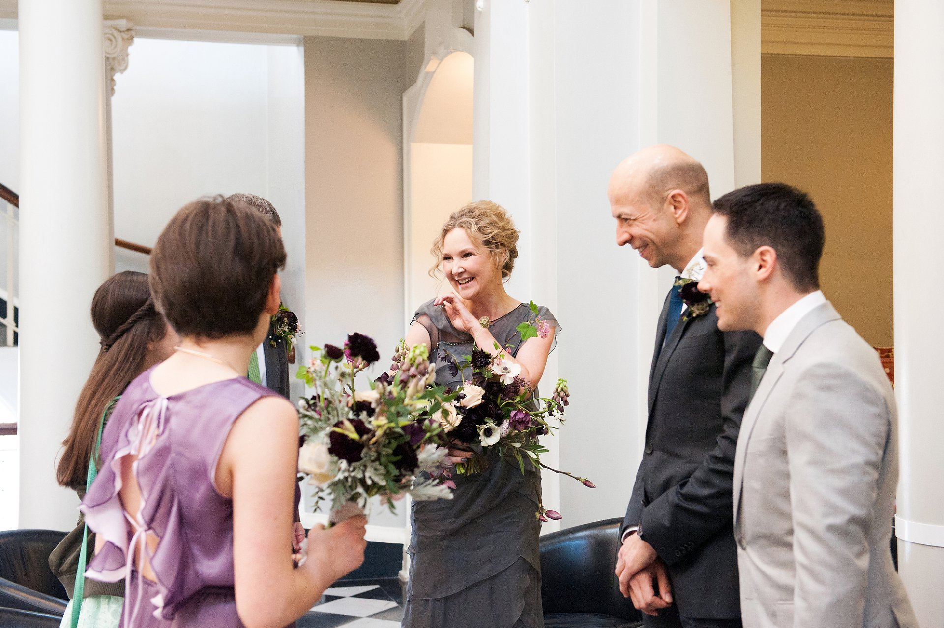 Bride greets her guests inside Woolwich Town Hall for her Woolwich Town Hall wedding