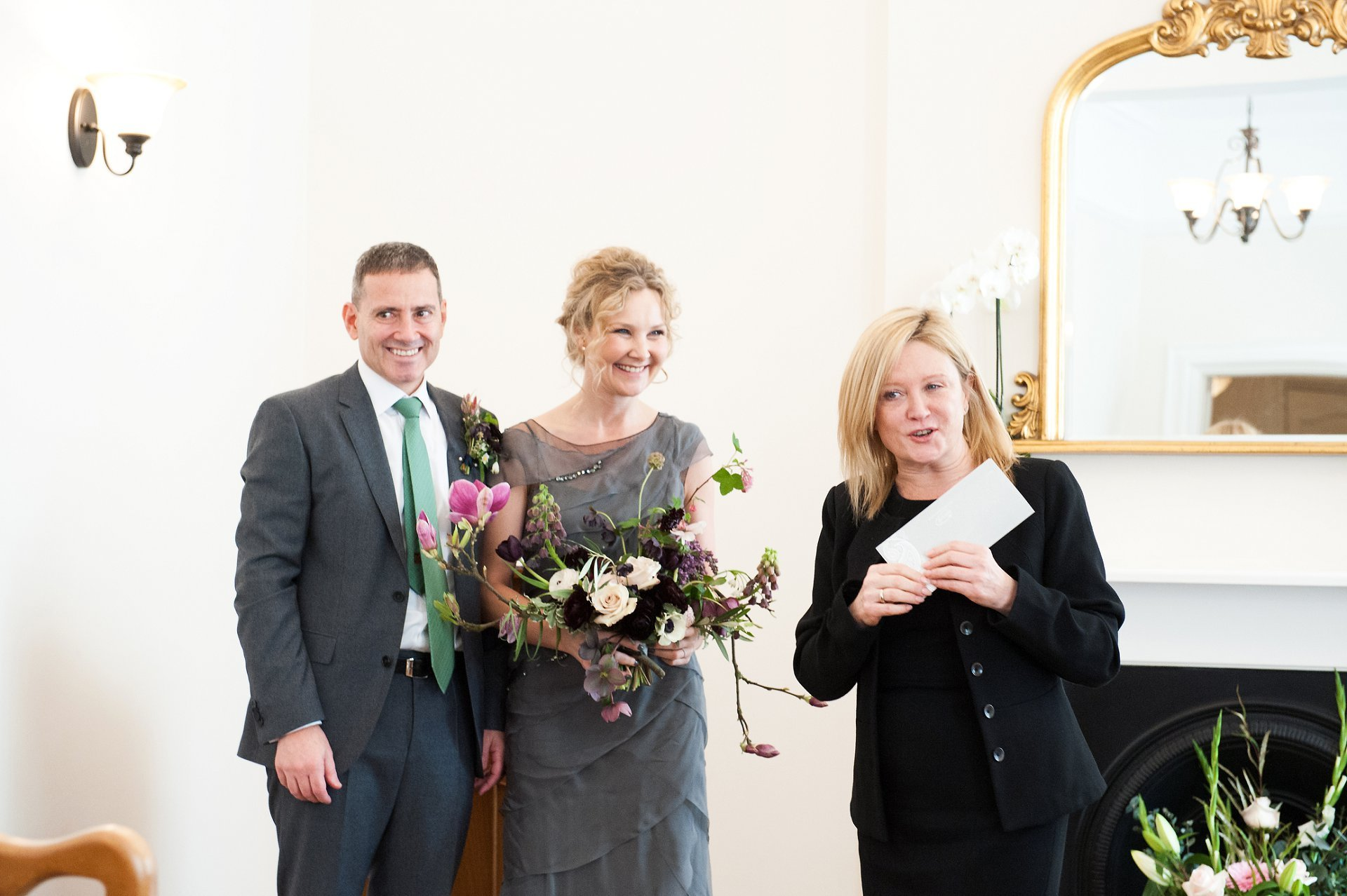 Greenwich Registrar hands over Wedding Certificate to Bride and Groom at Woolwich Town Hall