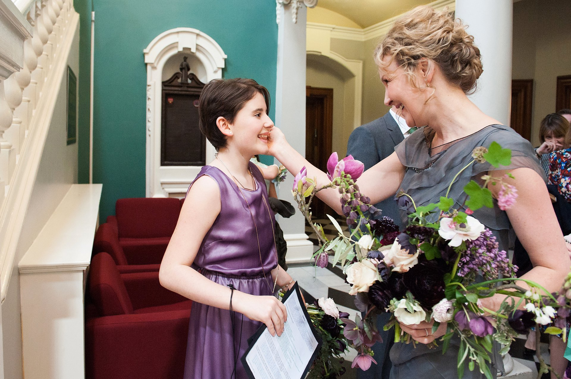 Bride and bridesmaid in the Victoria Hall at Woolwich Town Hall
