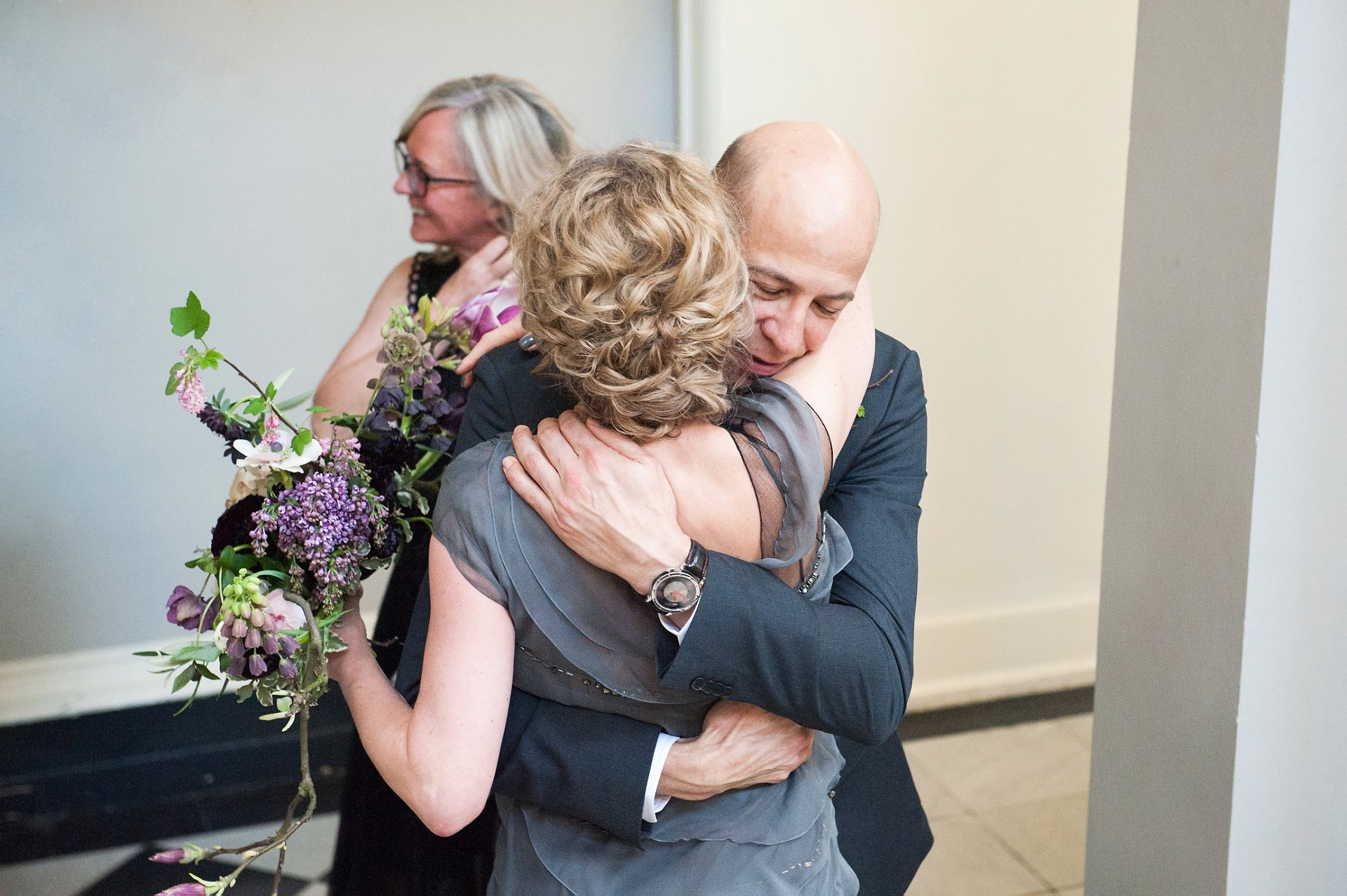 Bride and her Brother embrace after wedding ceremony in Greenwich Registry Office