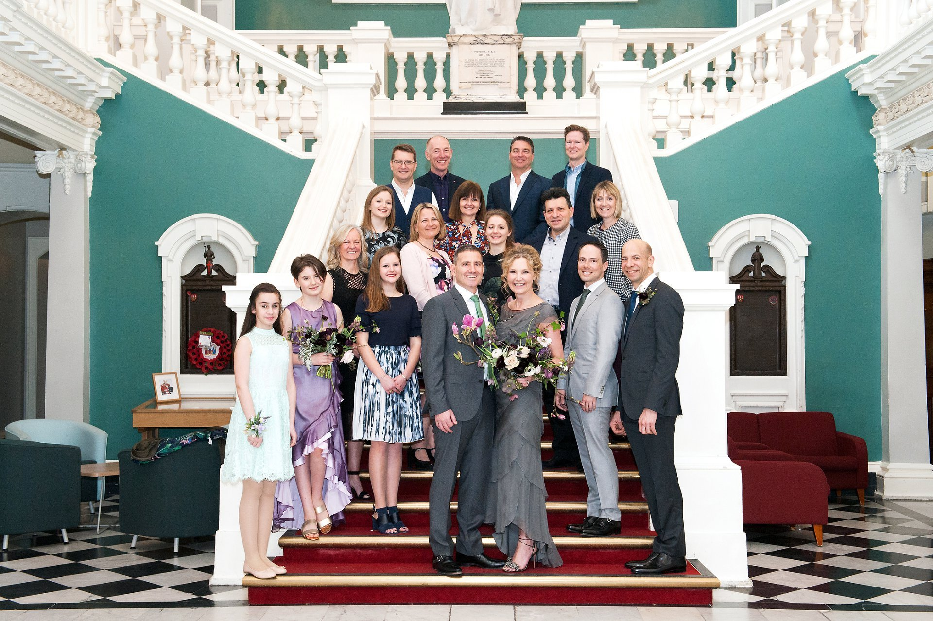 Wedding photography group on the red staircase of the Victoria Hall, Woolwich Town Hall, Woolwich Town Hall