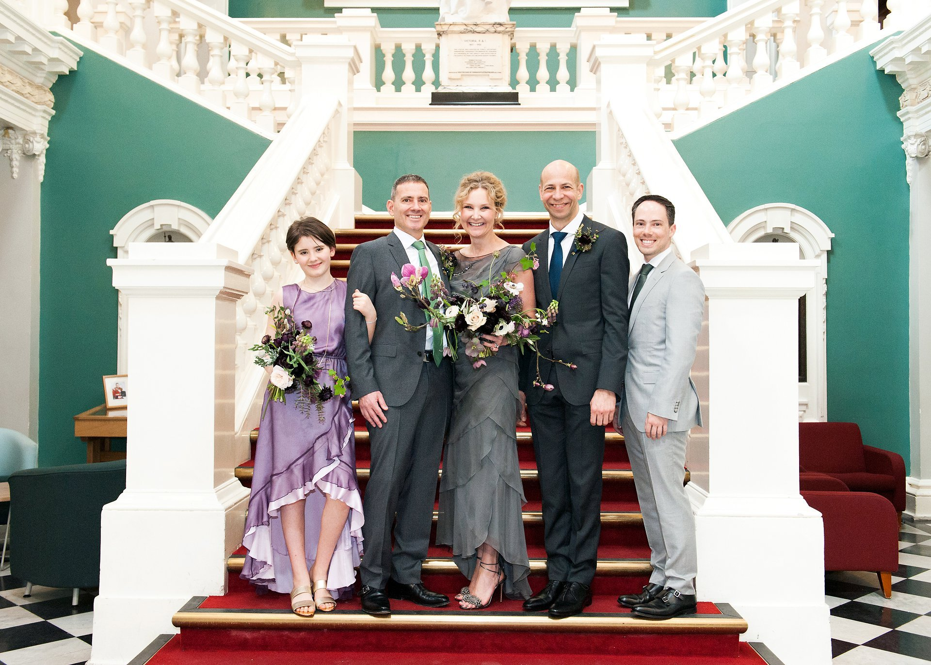 Family group photography on the red staircase inside Woolwich Town Hall