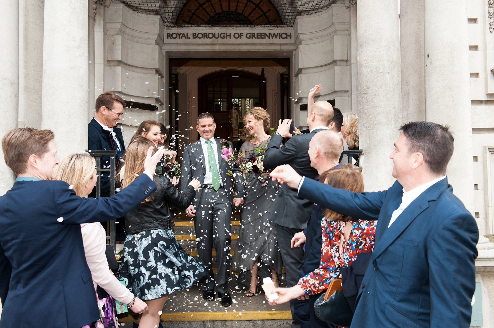 Bride & Groom leaving Woolwich Town Hall (Wellington Entrance) with guests throwing confetti to celebrate their marriage