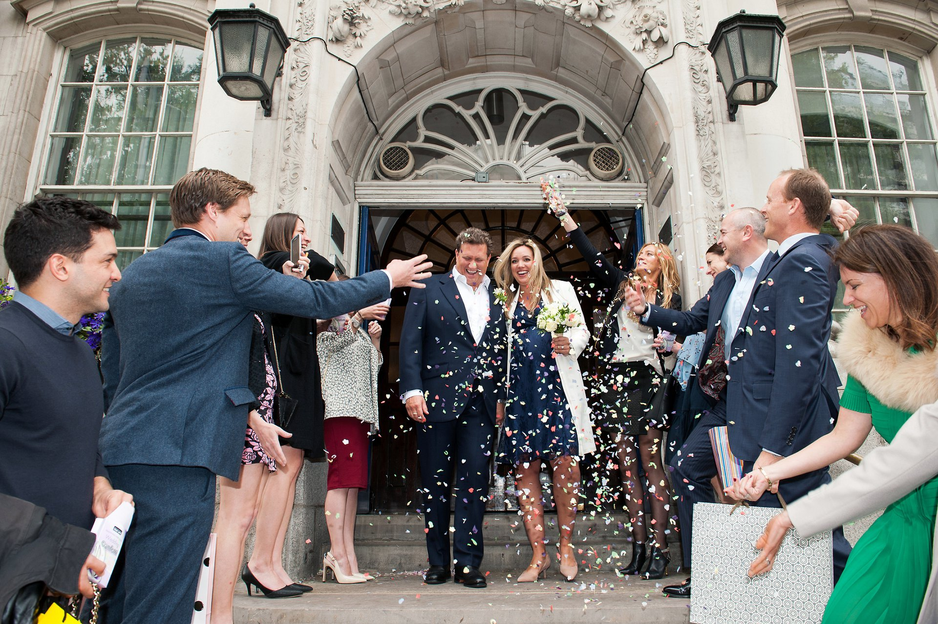 The famous Chelsea Old Town Hall steps with Julian and Emily exiting to a hail of confetti