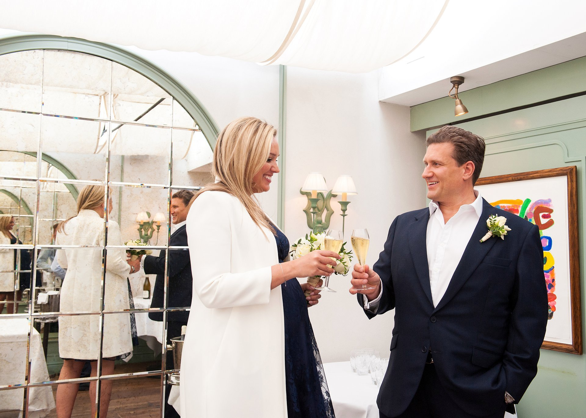Julian and Emily toast their marriage with a glass of champagne