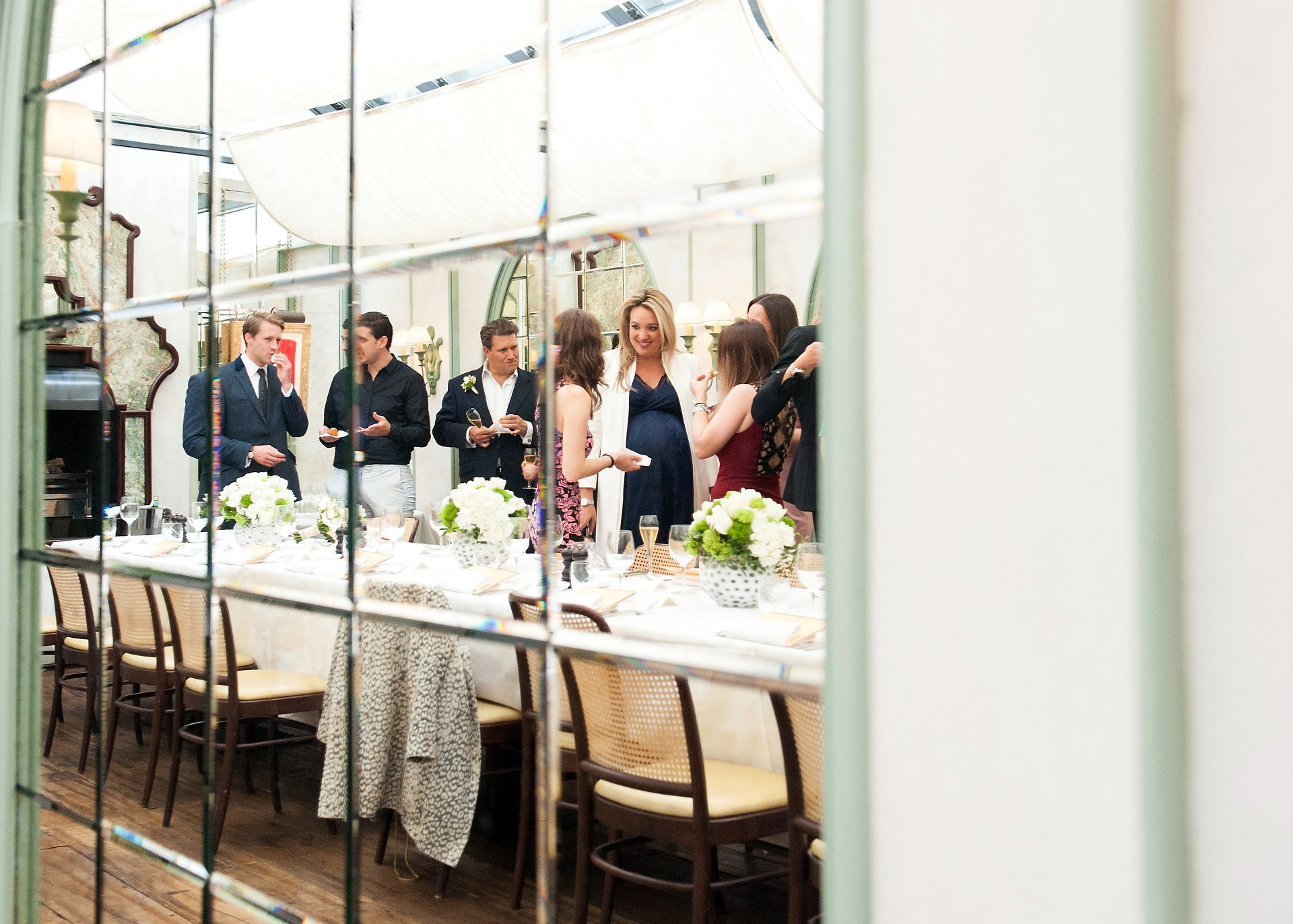 Guests enjoying the private Daphne's Conservatory during a wedding reception