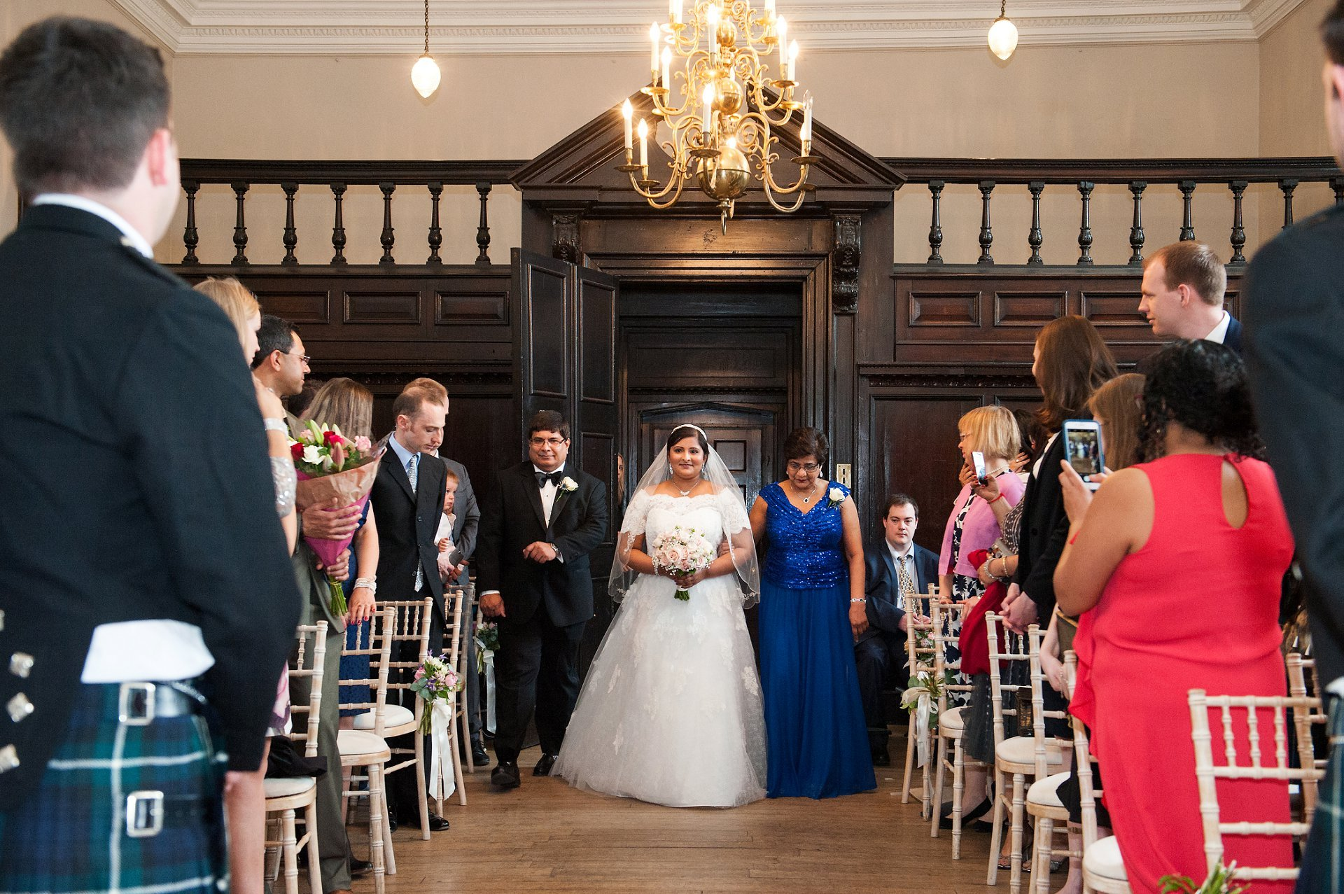 Bride, Feriel, and her parents enter the Great Hall at Fulham Palace for her marriage to Adam