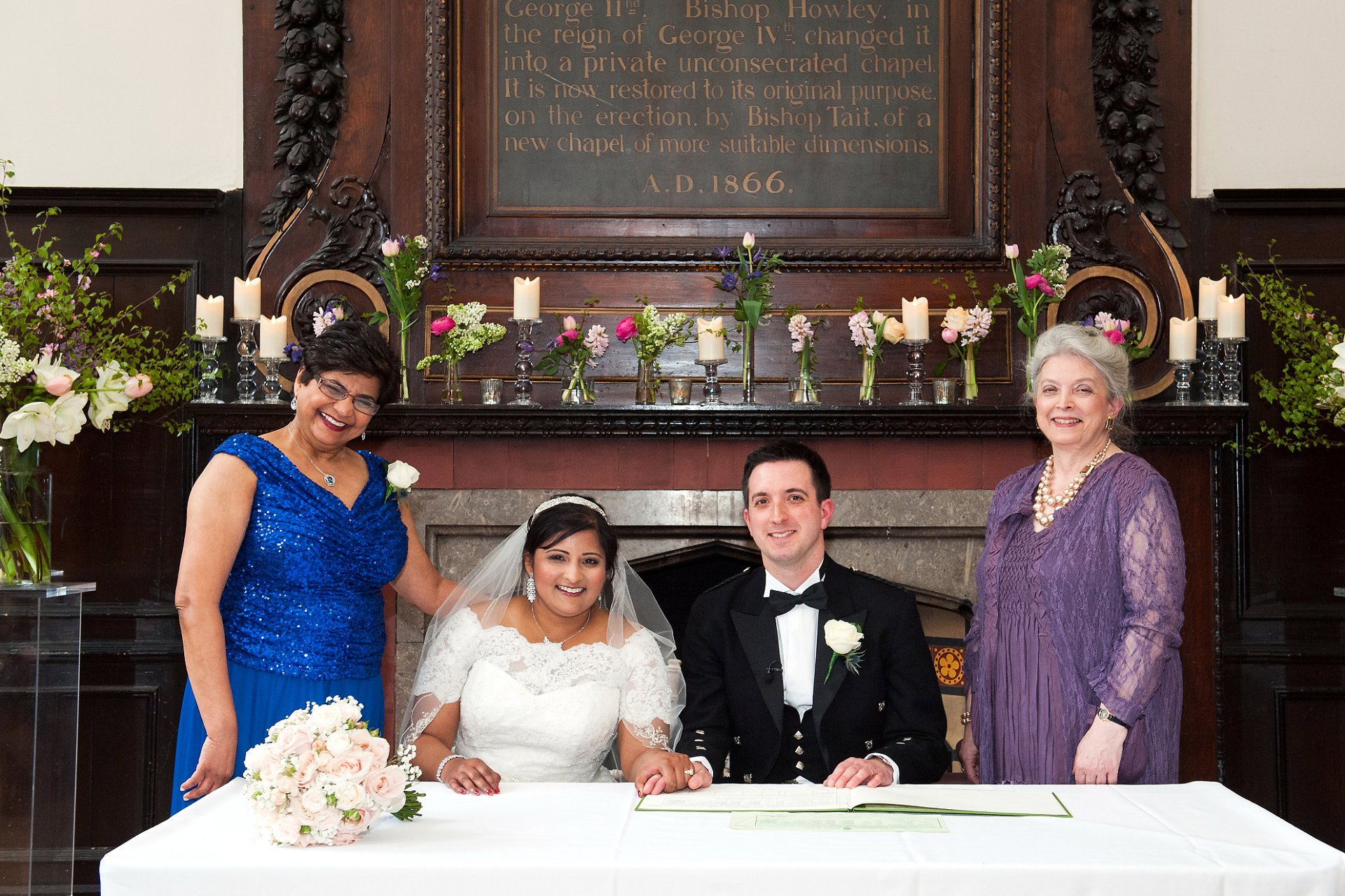 Bride & Groom and their mothers during signing of the register in the Great Hall at Fulham Palace
