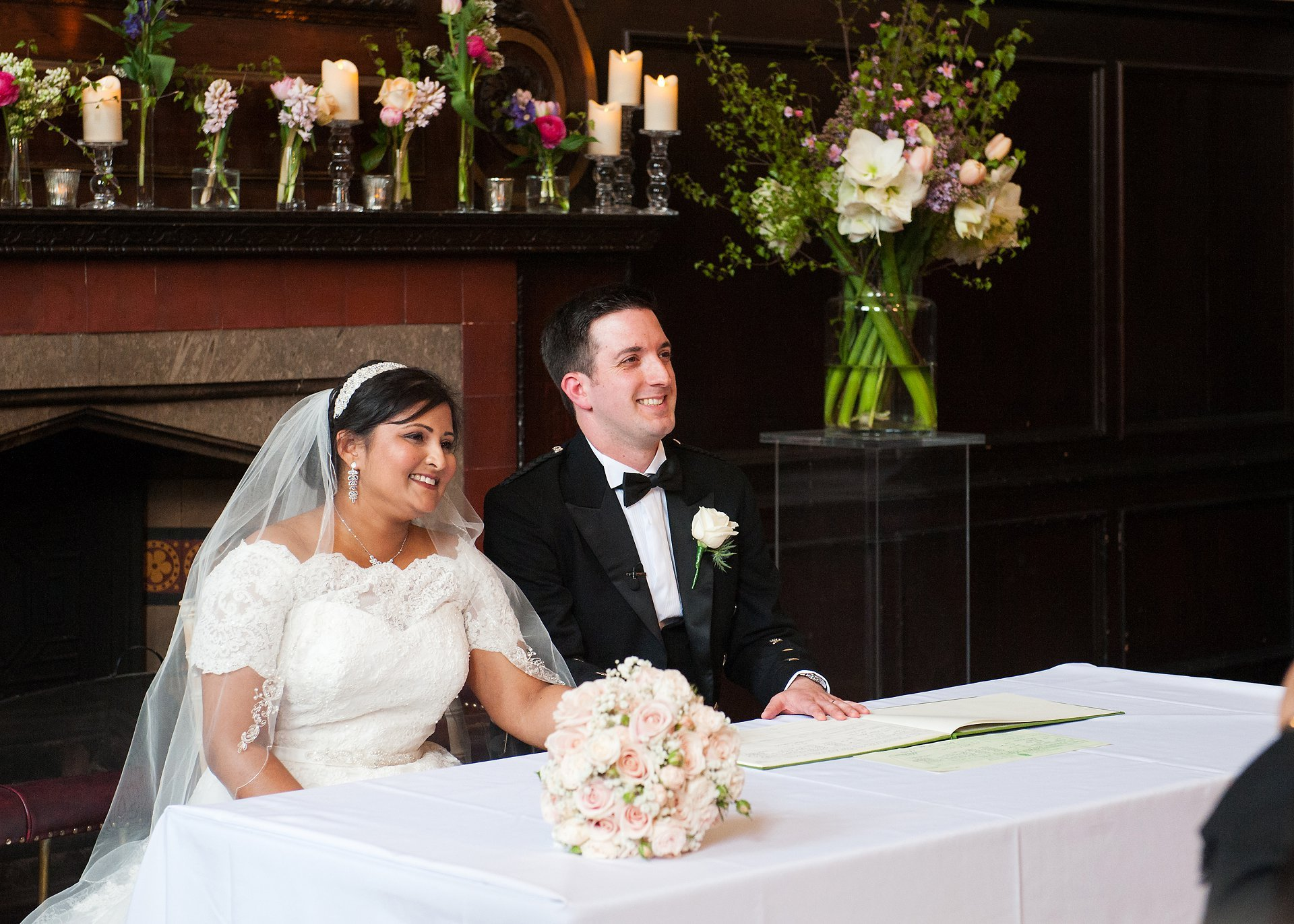 Bride & groom smile for the cameras after their Fulham Palace Great Hall wedding