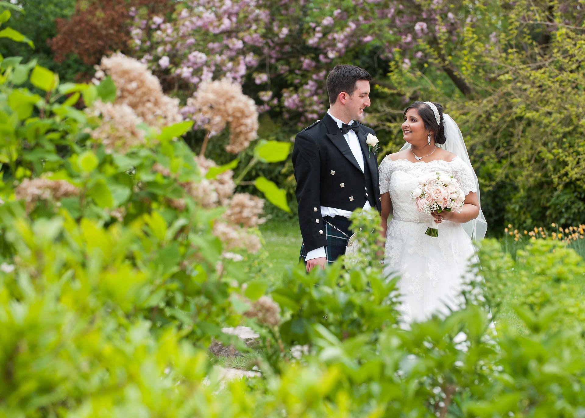 Bride & Groom in the gardens of Fulham Palace after their civil marriage ceremony
