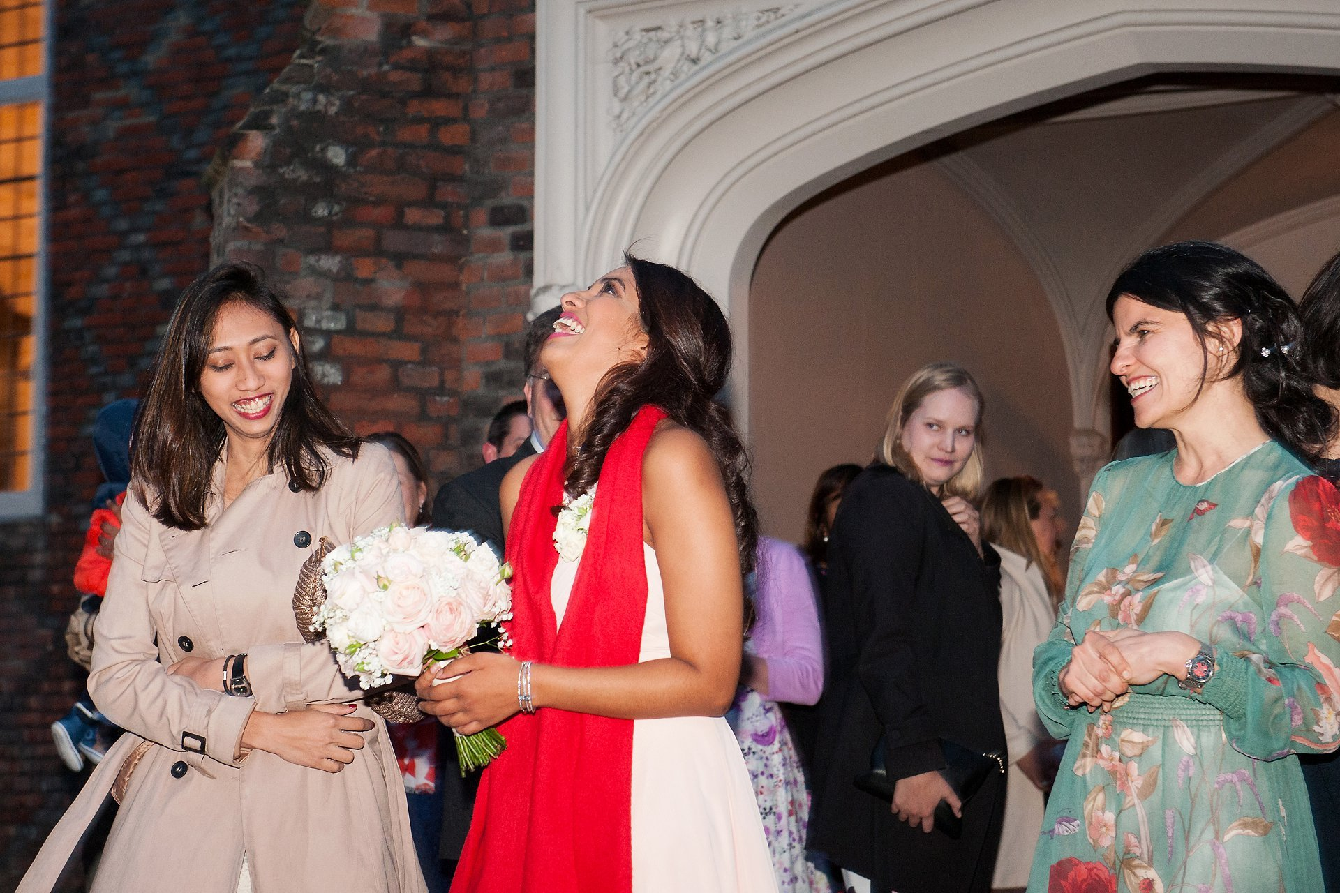 Throwing of the bouquet in the courtyard at Fulham Palace