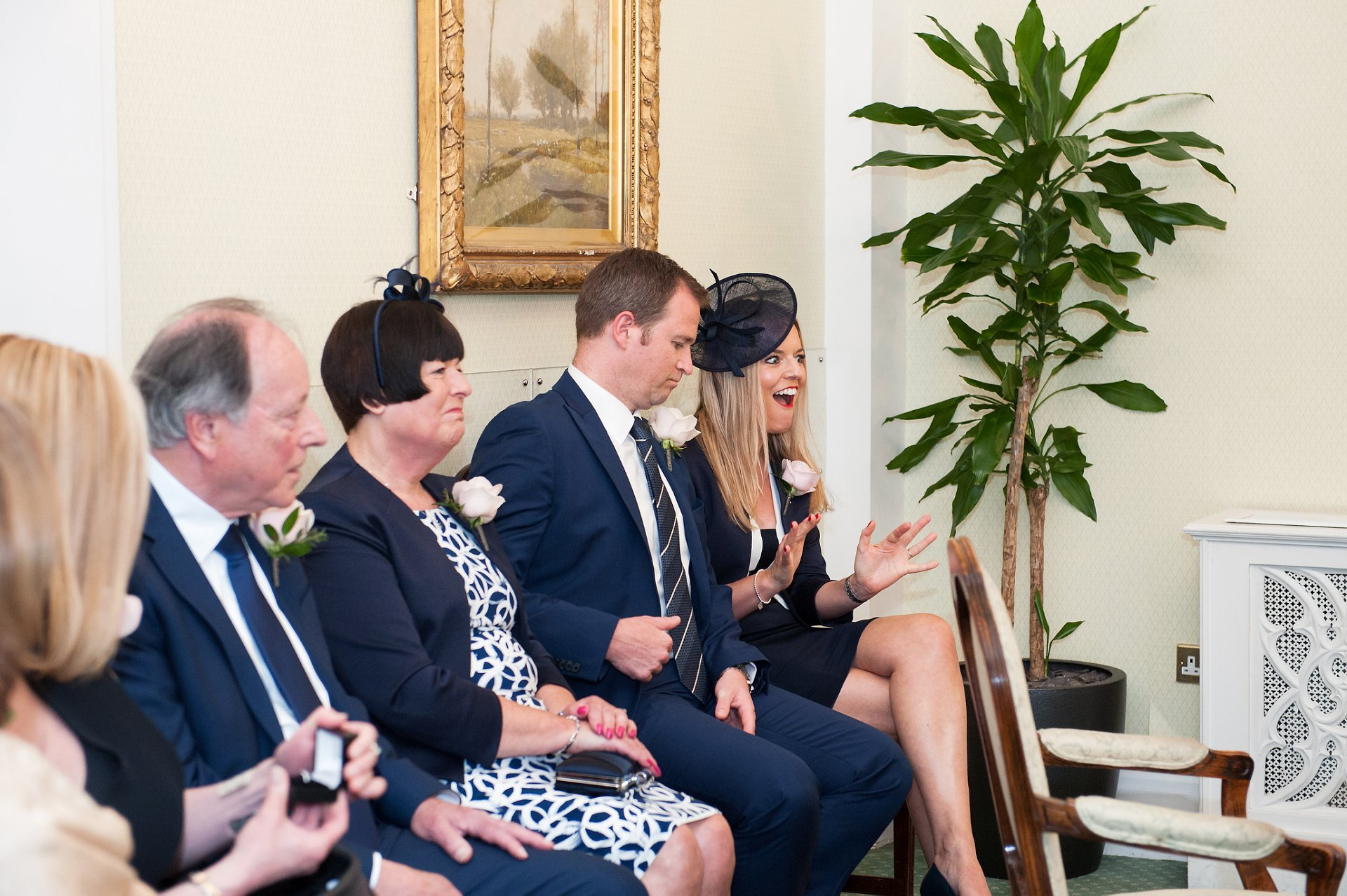 Guests laughing during the civil ceremony at Chelsea Register Office