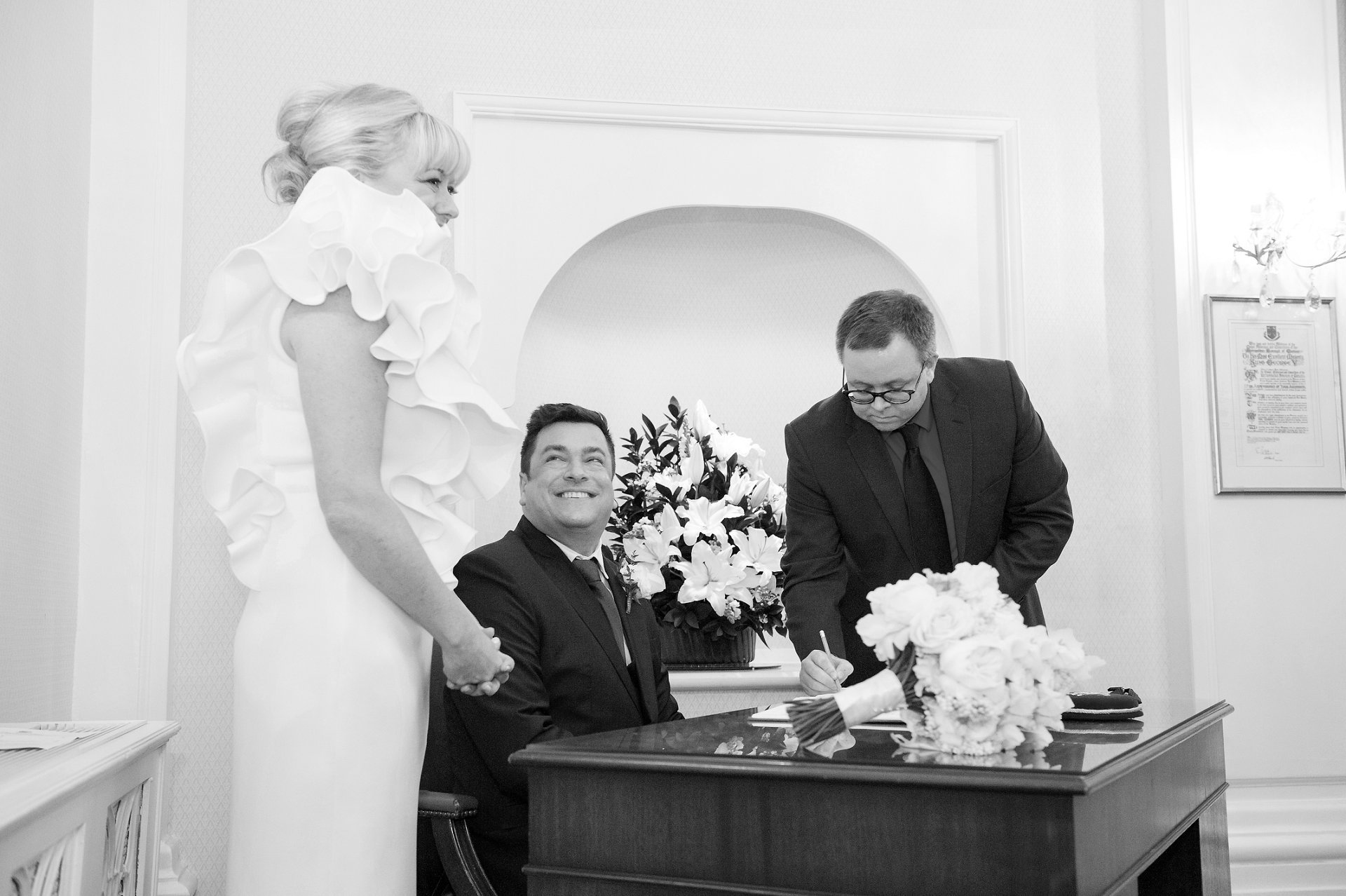 Groom looks at his Bride during Register signing at Chelsea Register Office