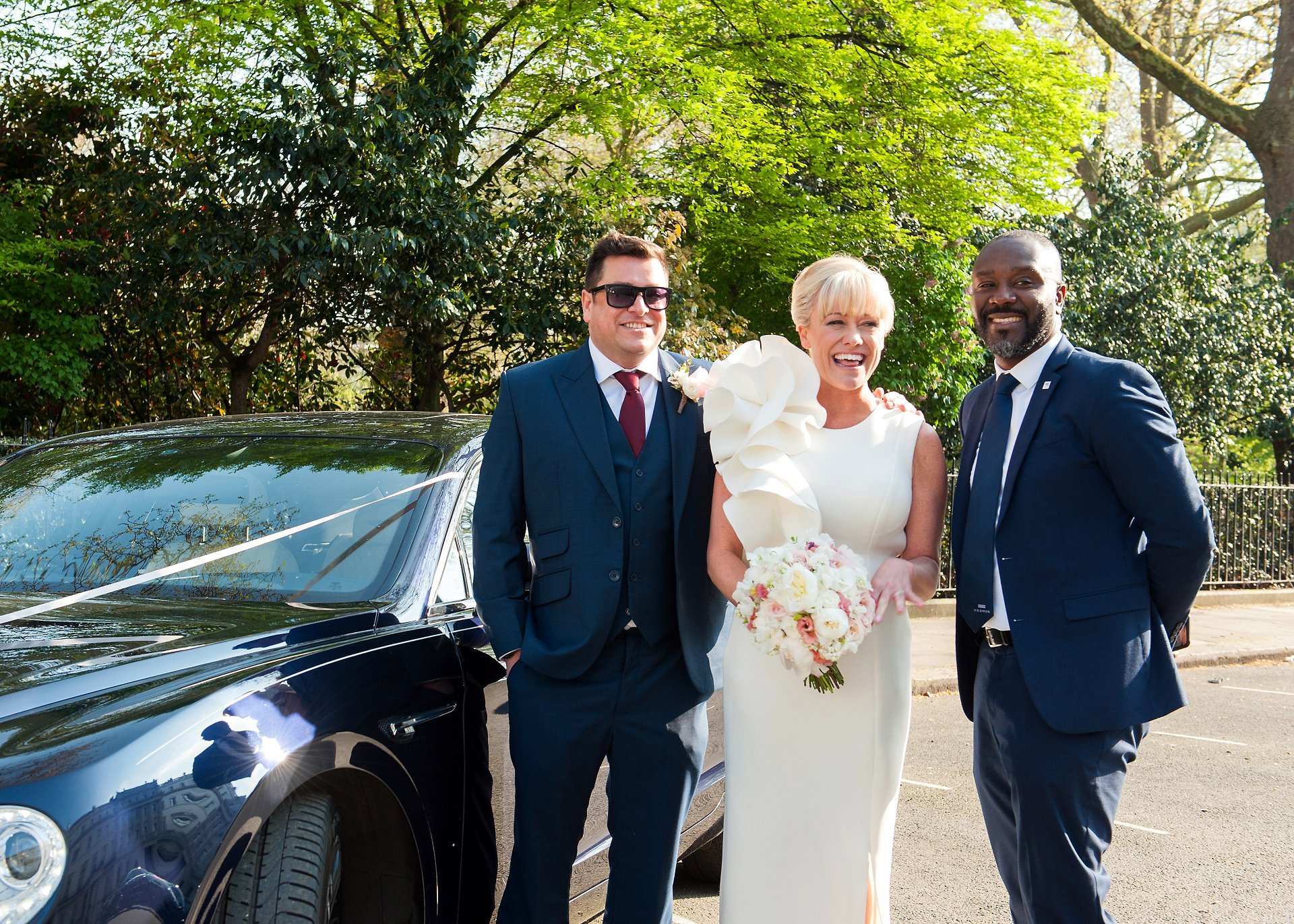 Bride & Groom with their Bentley wedding car driver on Belgrave Square, London