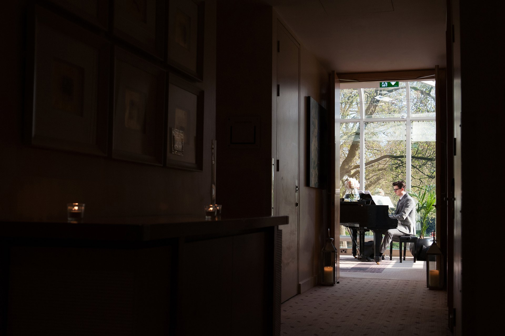 A pianist plays the piano during a reception in the Garden Room at the Jumeirah Carlton Tower in Knightbridge
