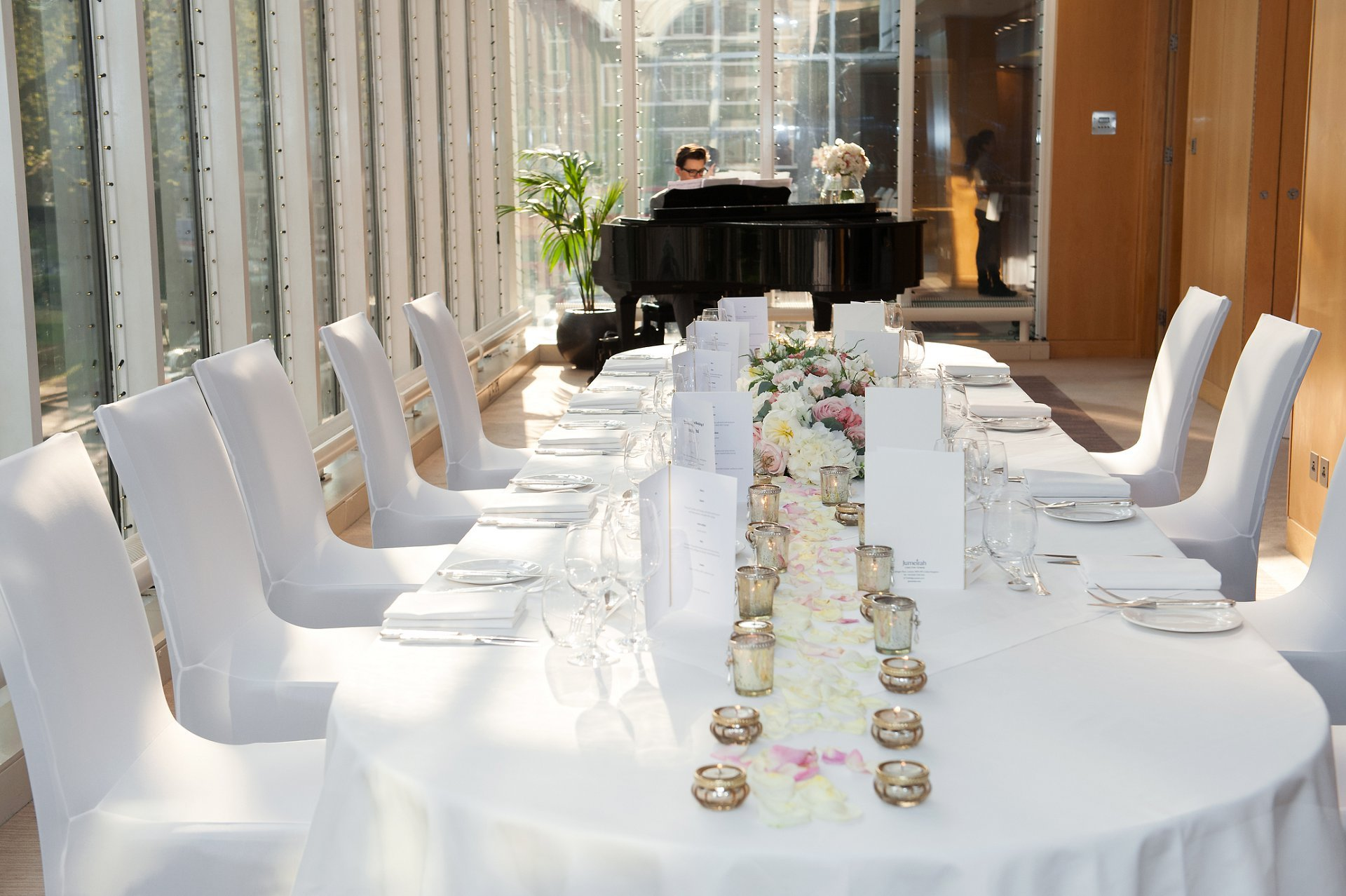 The Garden Room at Jumeirah Carlton Tower in Knightsbridge laid for an intimate wedding breakfast