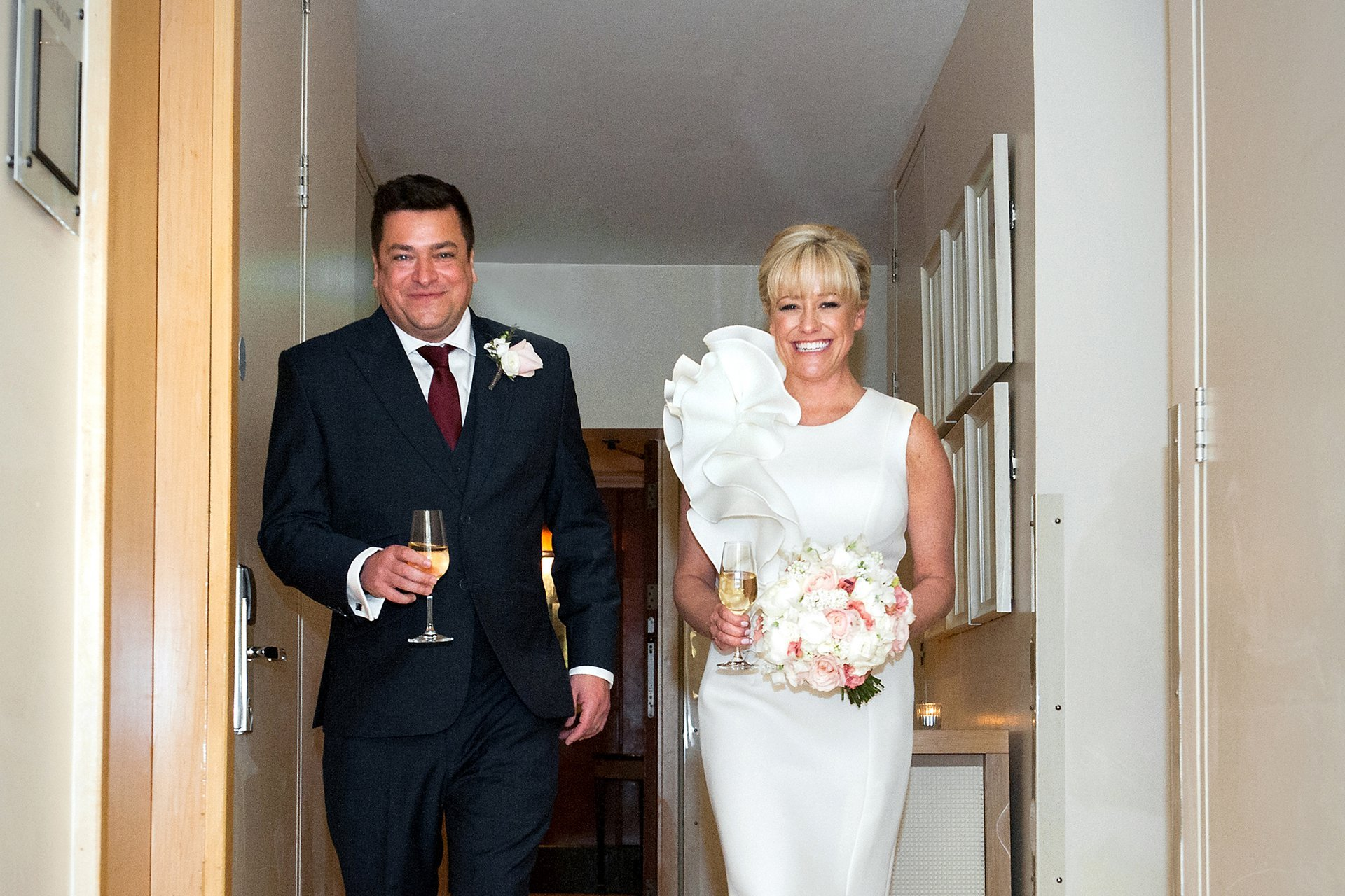Bride & Groom enter the Garden Room at Jumeirah Carlton Tower for their wedding reception