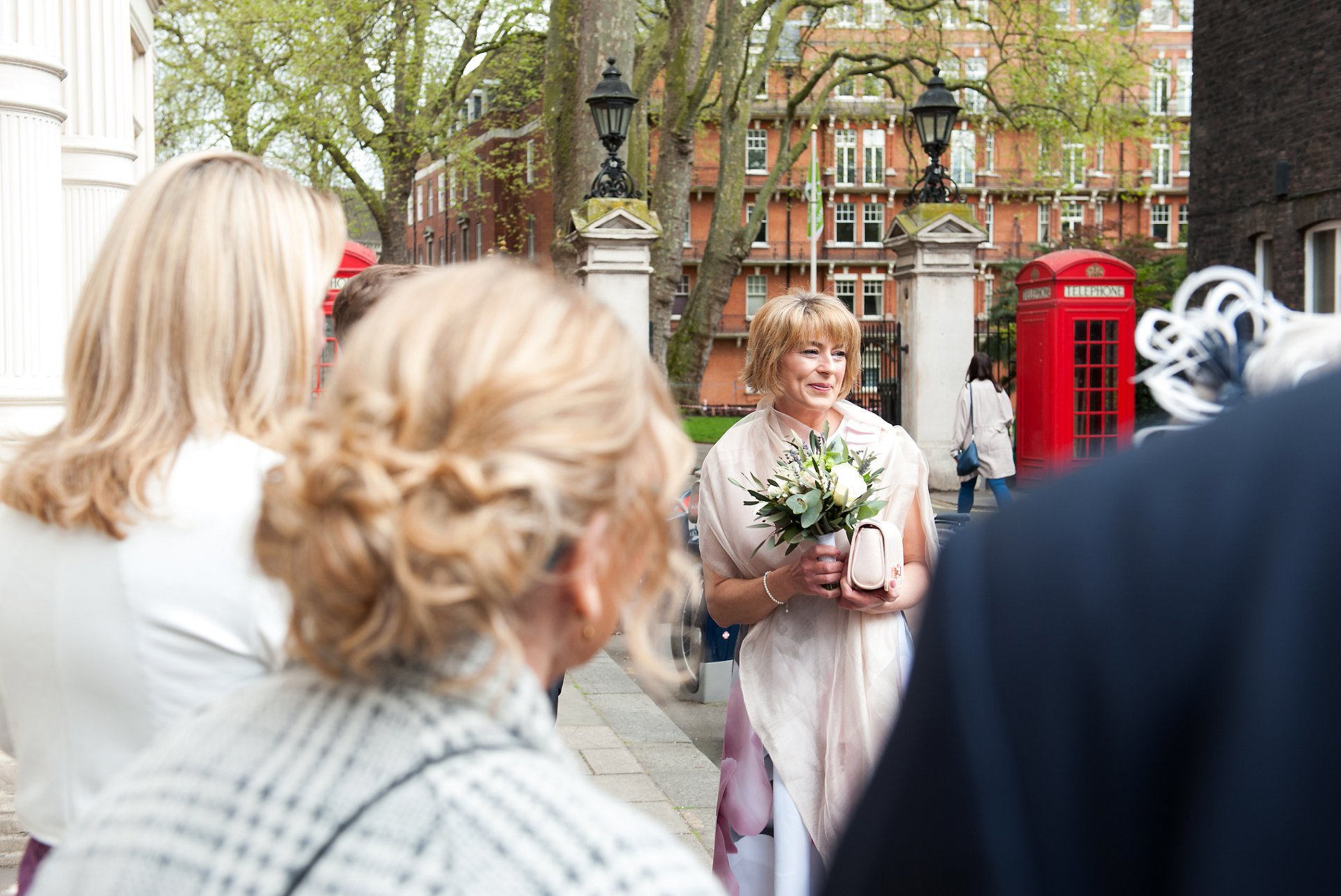 Bride, Melanie, outside Mayfair Library before her civil wedding ceremony at Marylebone Register Office