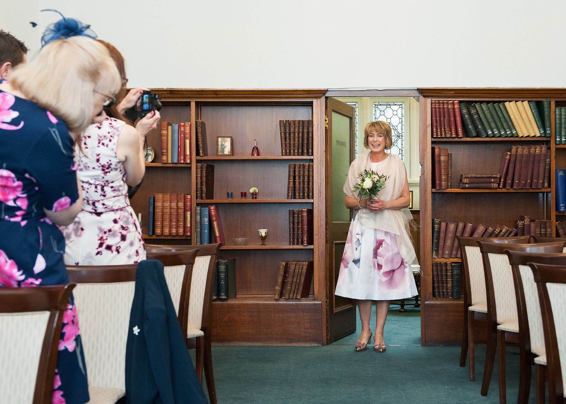 Melanie enters the Marylebone Room and walks down to aisle to join her husband-to-be for their civil marriage