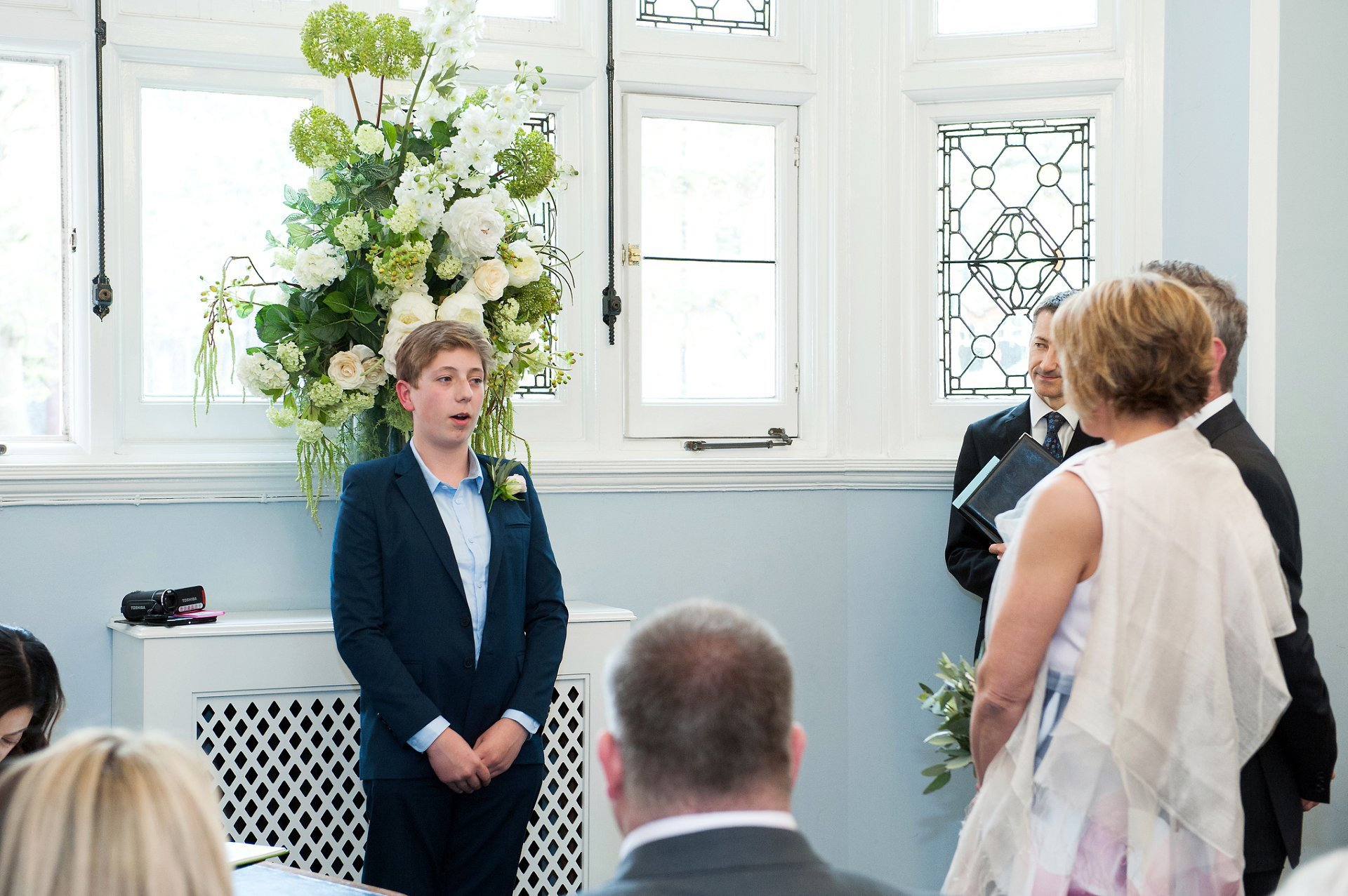 The bride & groom's son does a reading, learnt by heart, to the guests at melanie & Sid's wedding