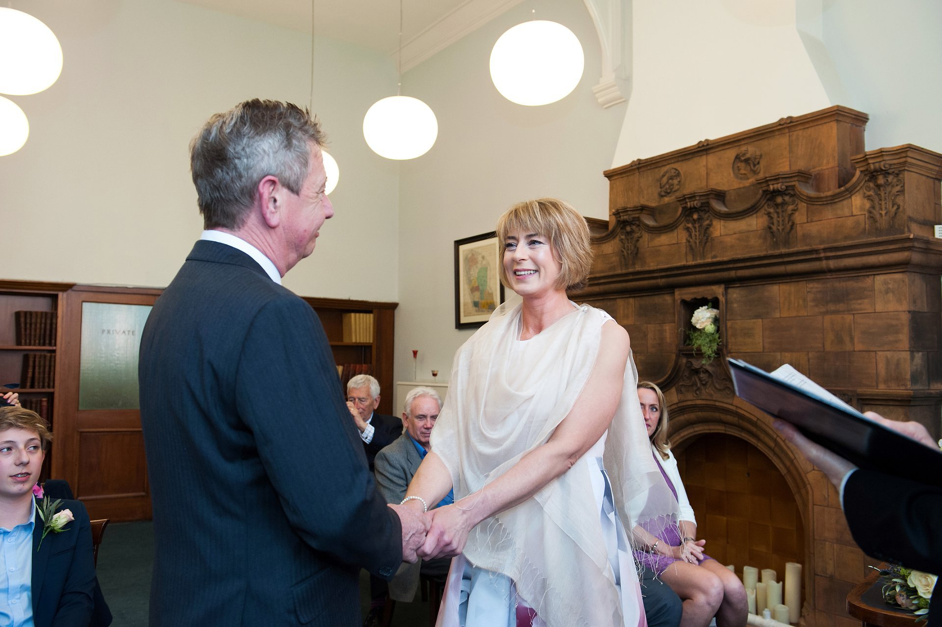 Bride & Groom exchange vows in the Marylebone Room of Mayfair Library, the Marylebone Registry Office