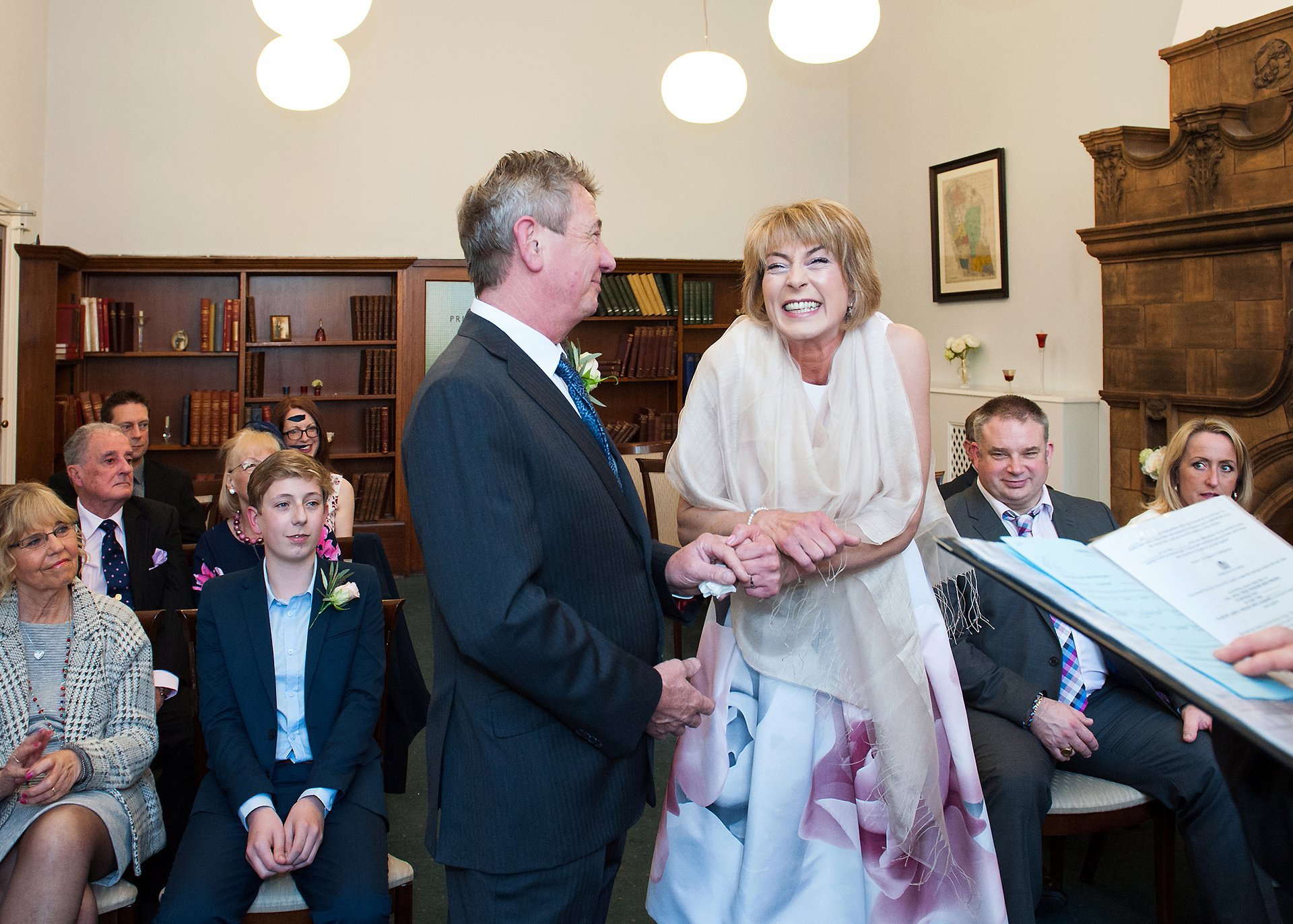 Bride smiles with glee when their marriage is official in Mayfair Library, Westminster, London