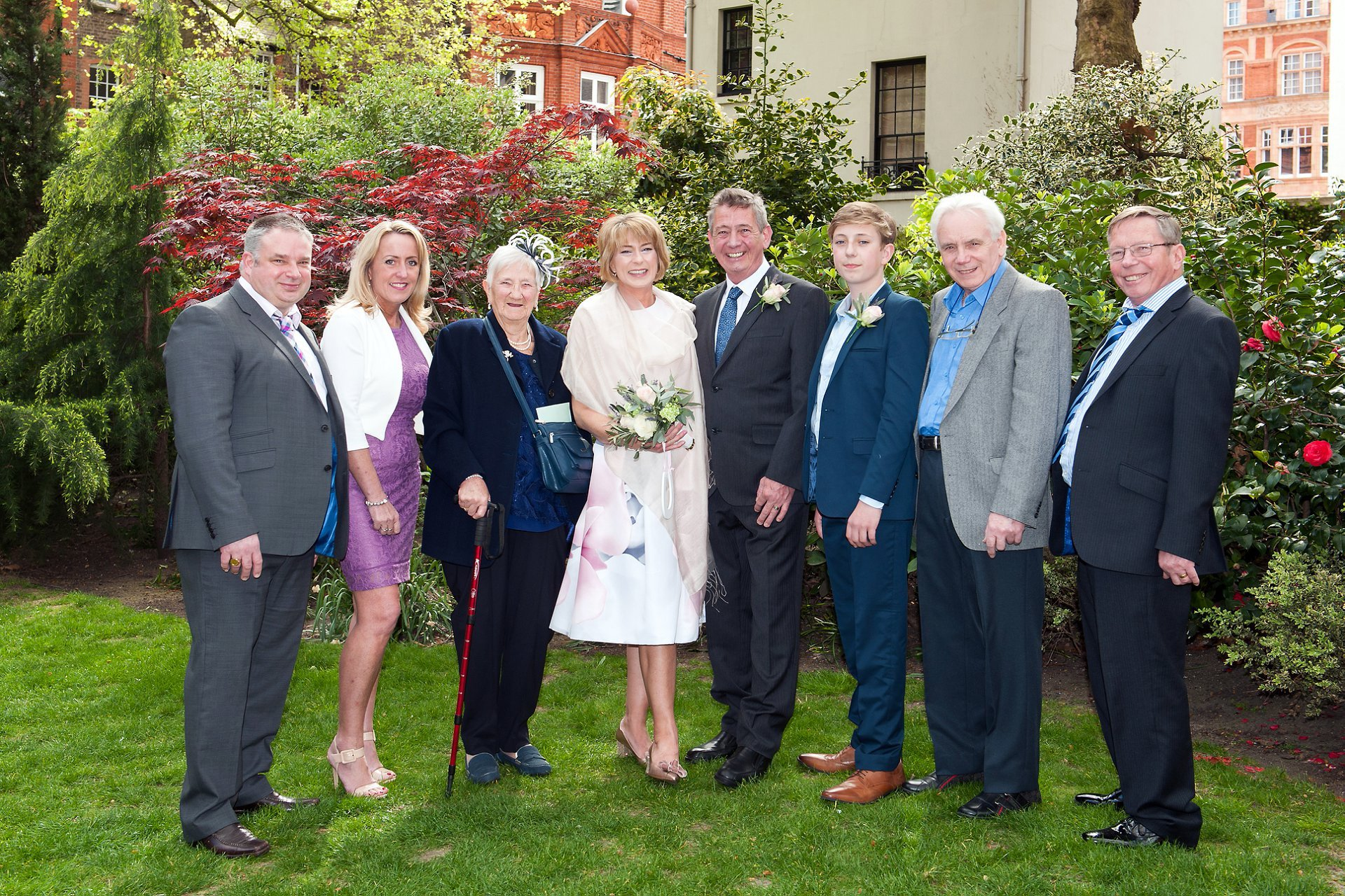 A family wedding photogrpah taken in Mount Street Gardens, Mayfair