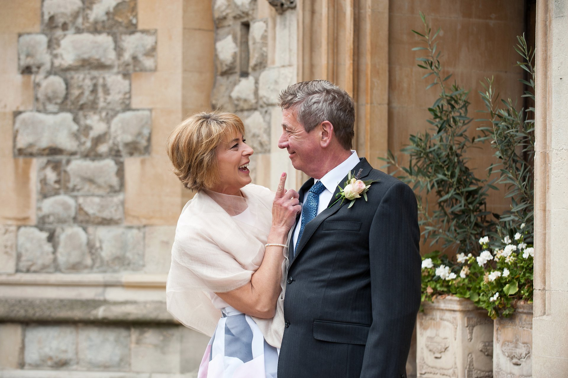 Bride & groom laughing after their Marylebone wedding