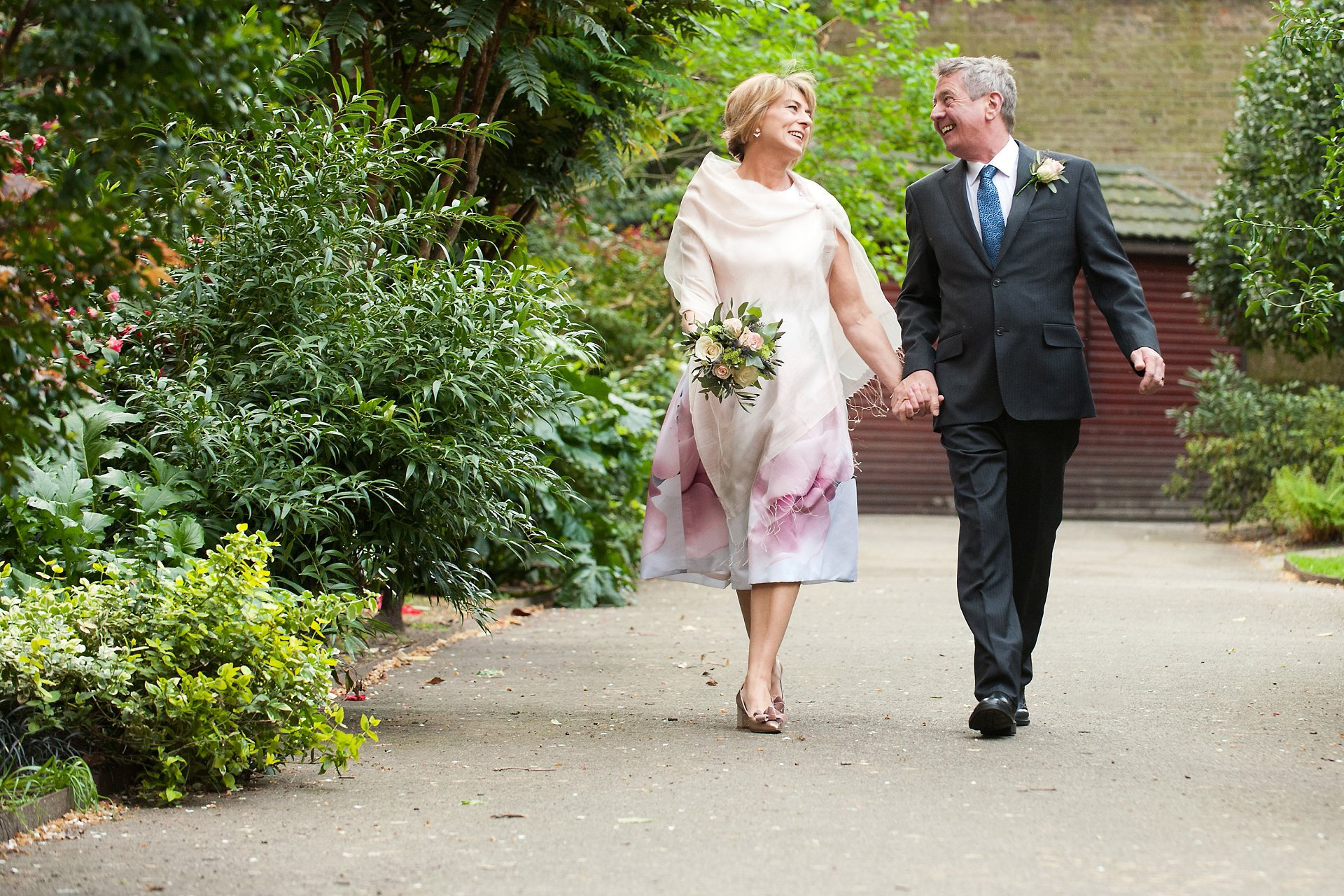 Bride & groom celebrate their Mayfair Library wedding in Mount Street Gardens