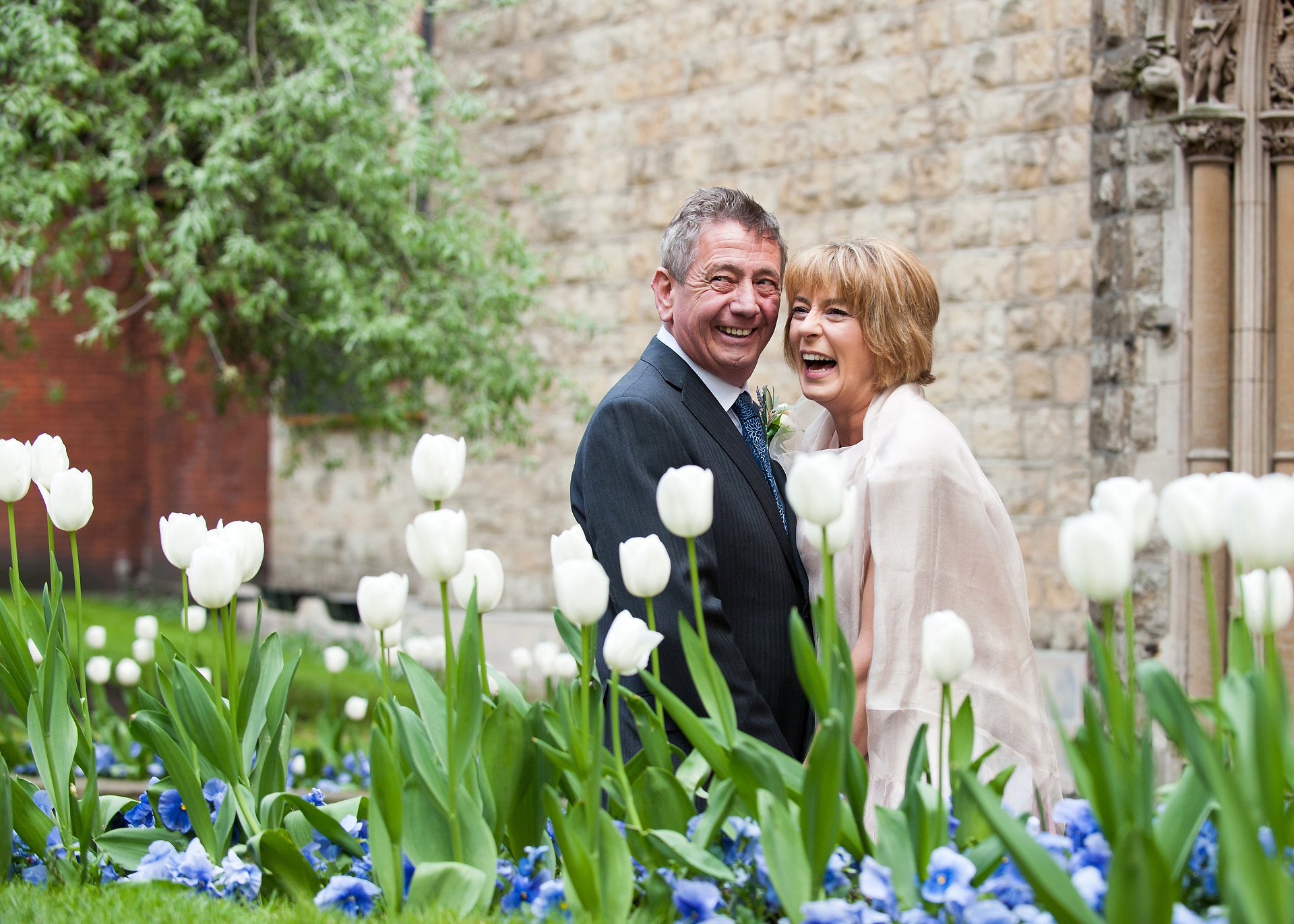 Bride & groom in Mount Street Gardens with pretty tulips signifying spring